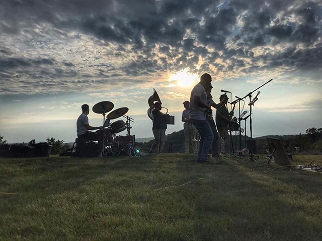 'There is another sky, Ever serene and fair'  Perhaps the best #bandpic we've seen 😊🙏🙌🙌🙌 * * * #breathtaking #view #band #gorgeousview #nofilter #wow #holycrap #brass #pictures #art #photogenic #gq #sunset #coverart #serene #trumpet #sousaphone #drums #sax #trombone #sillouette #music #gig #gigs #giglife #giglifstyle #fedorable  @arodiek @geoffgilldrums @caitrodiek @terlalavender @marygillmusic @traversecitytourism @bendavismusic