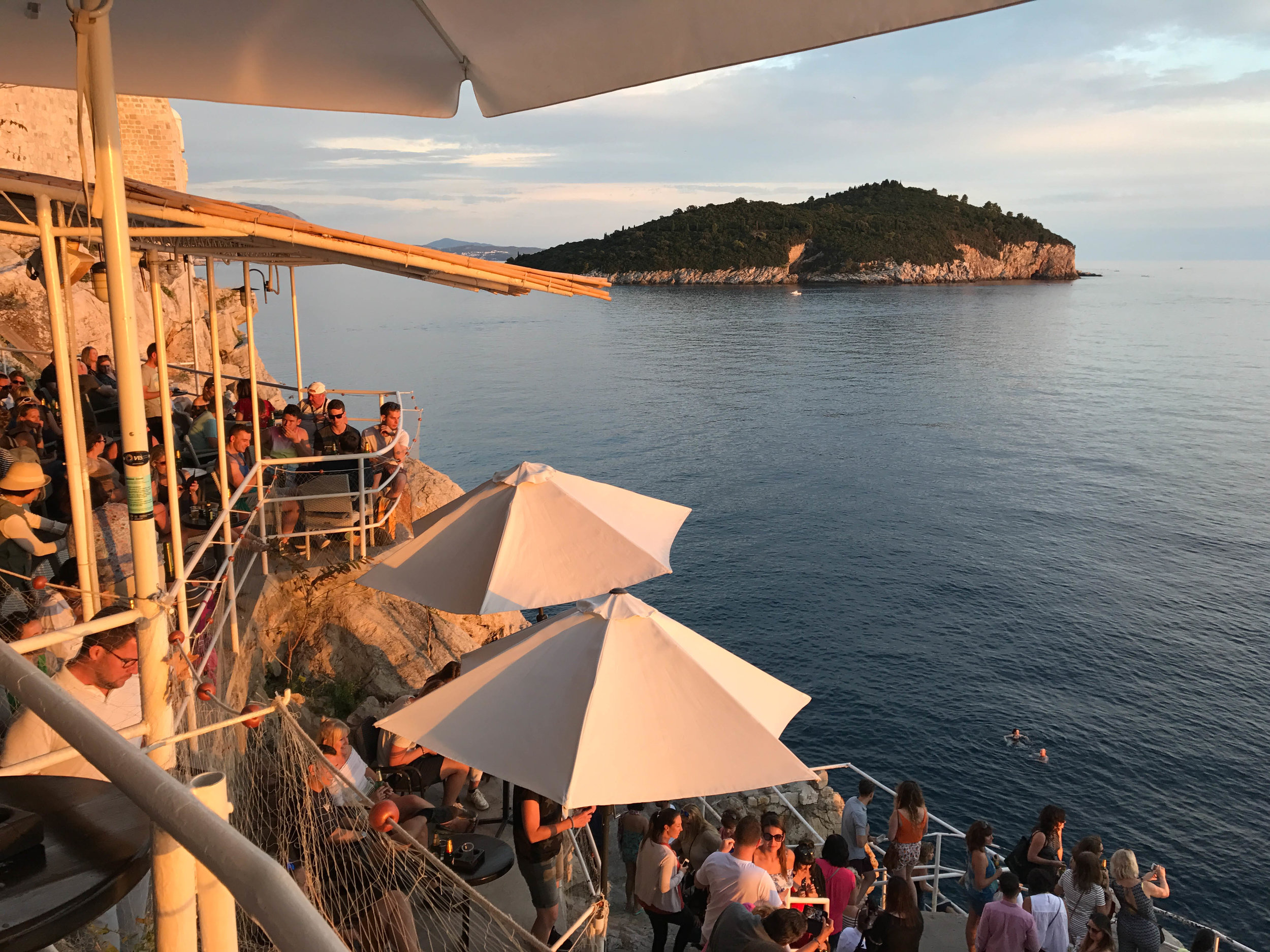 Sunset Drinks: Buza Bar - Pass through a hole in the fortress walls to access the bar, and you'll find a lovely terrace over the sea with incredible views.