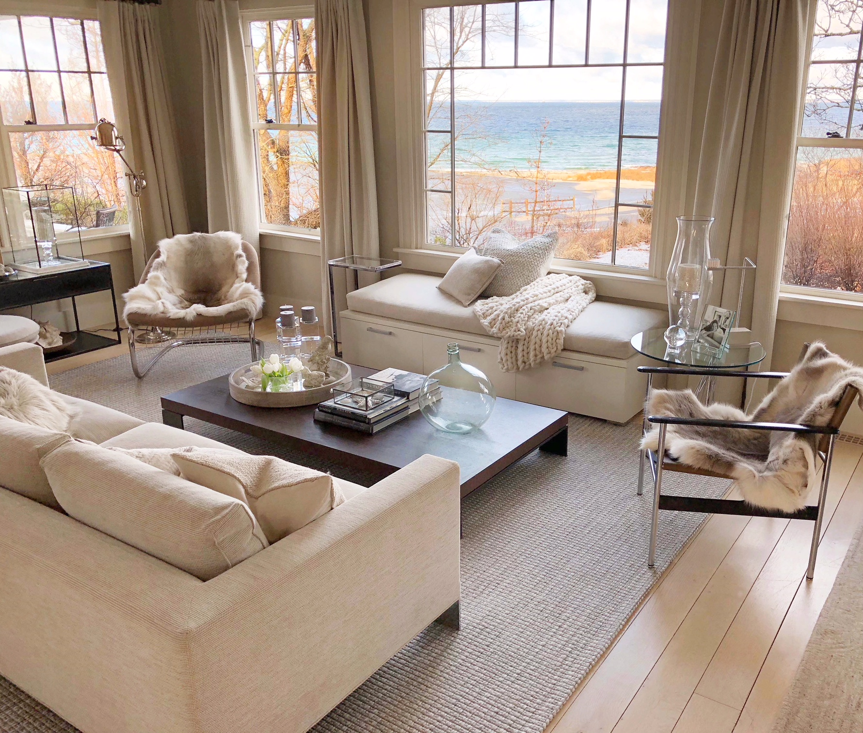 Neutral New England beach cottage living room with a vintage-modern mix. Design by Sandra Cavallo, @oldsilvershed