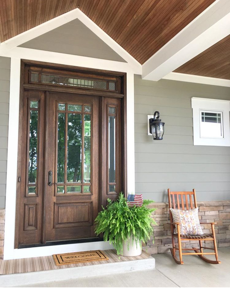 Front porch of a modern farmhouse painted with Cabot Solid Stain in Pewter Gray - Farmhouse Redefined