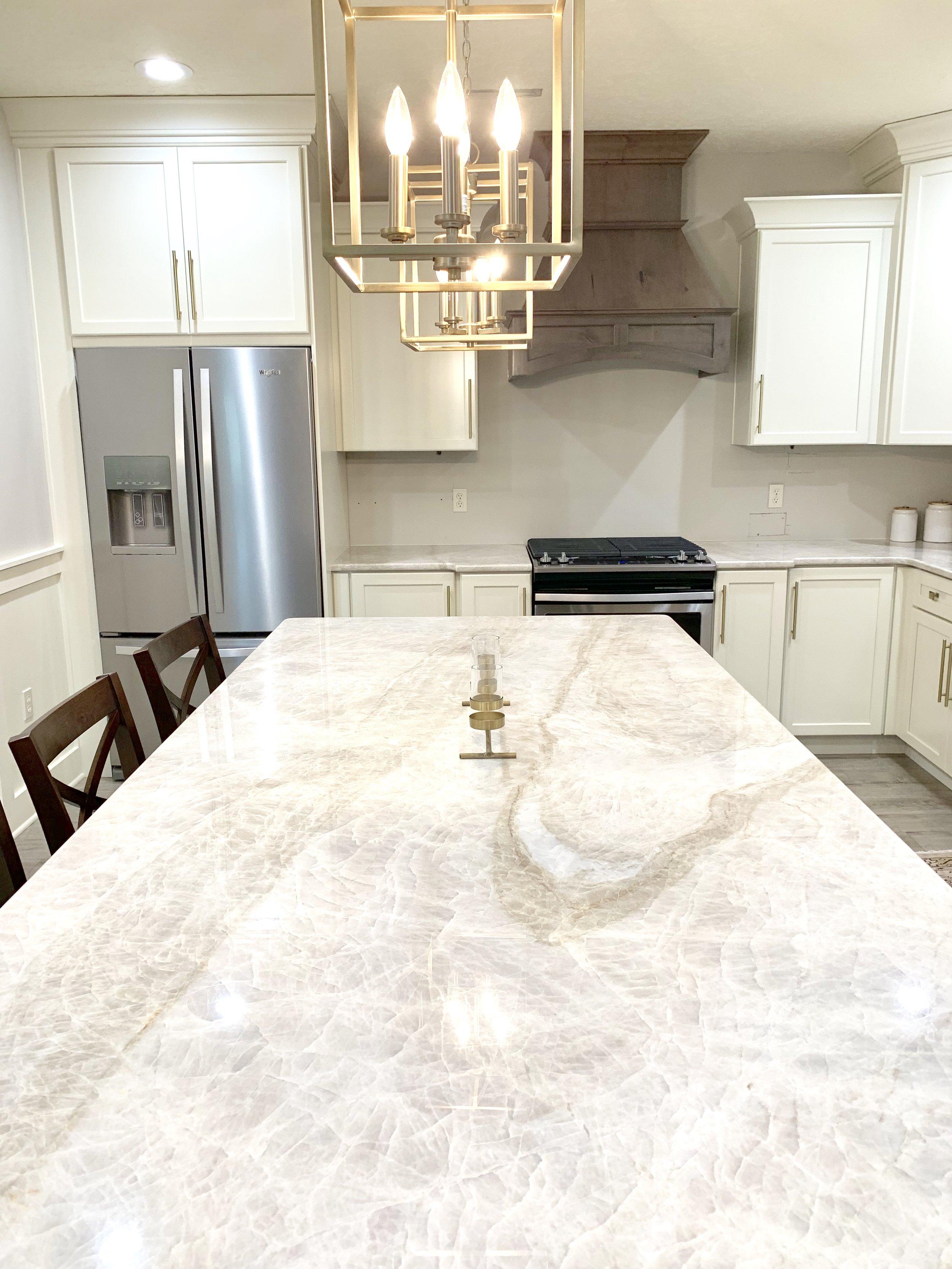 Taj Mahal quartzite countertops in modern farmhouse kitchen by Farmhouse Redefined.