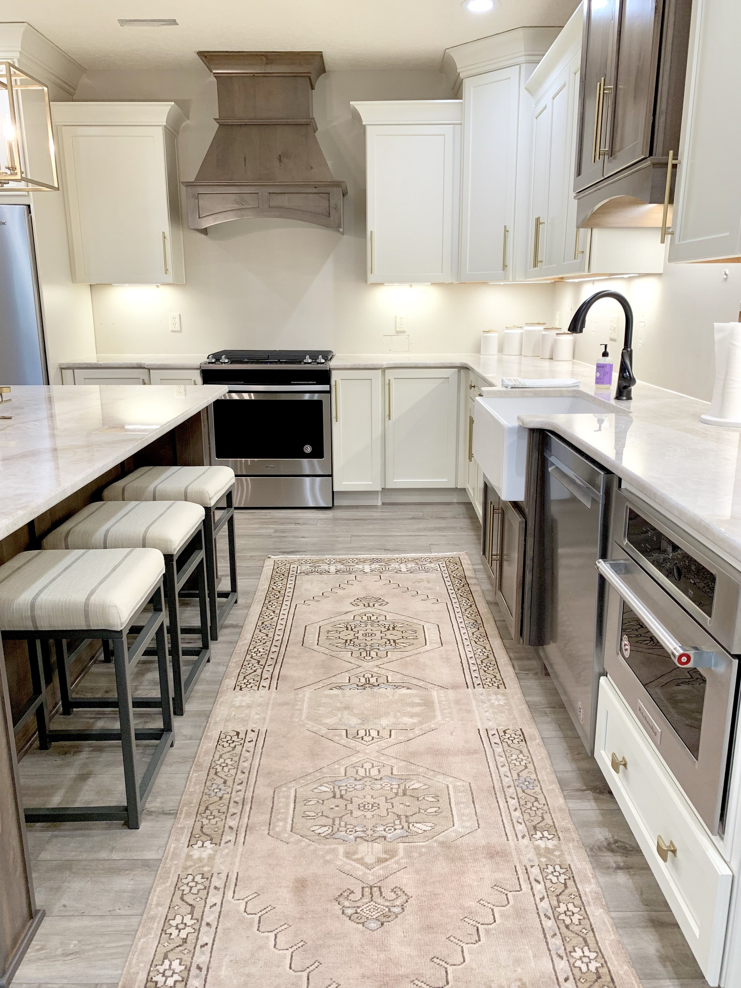 Vintage Oushak rug in modern farmhouse kitchen by Farmhouse Redefined.