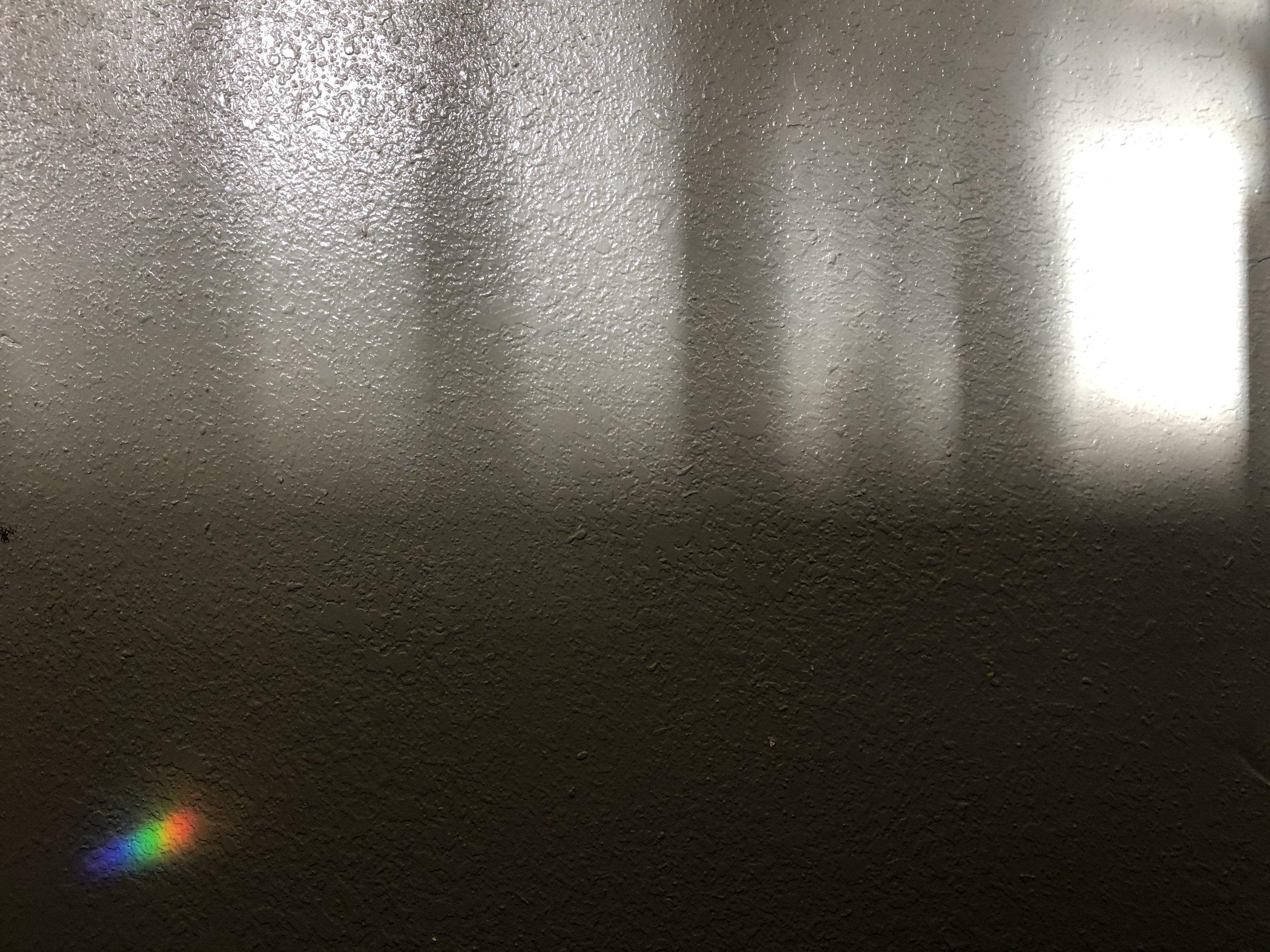 a rainbow on the wall.