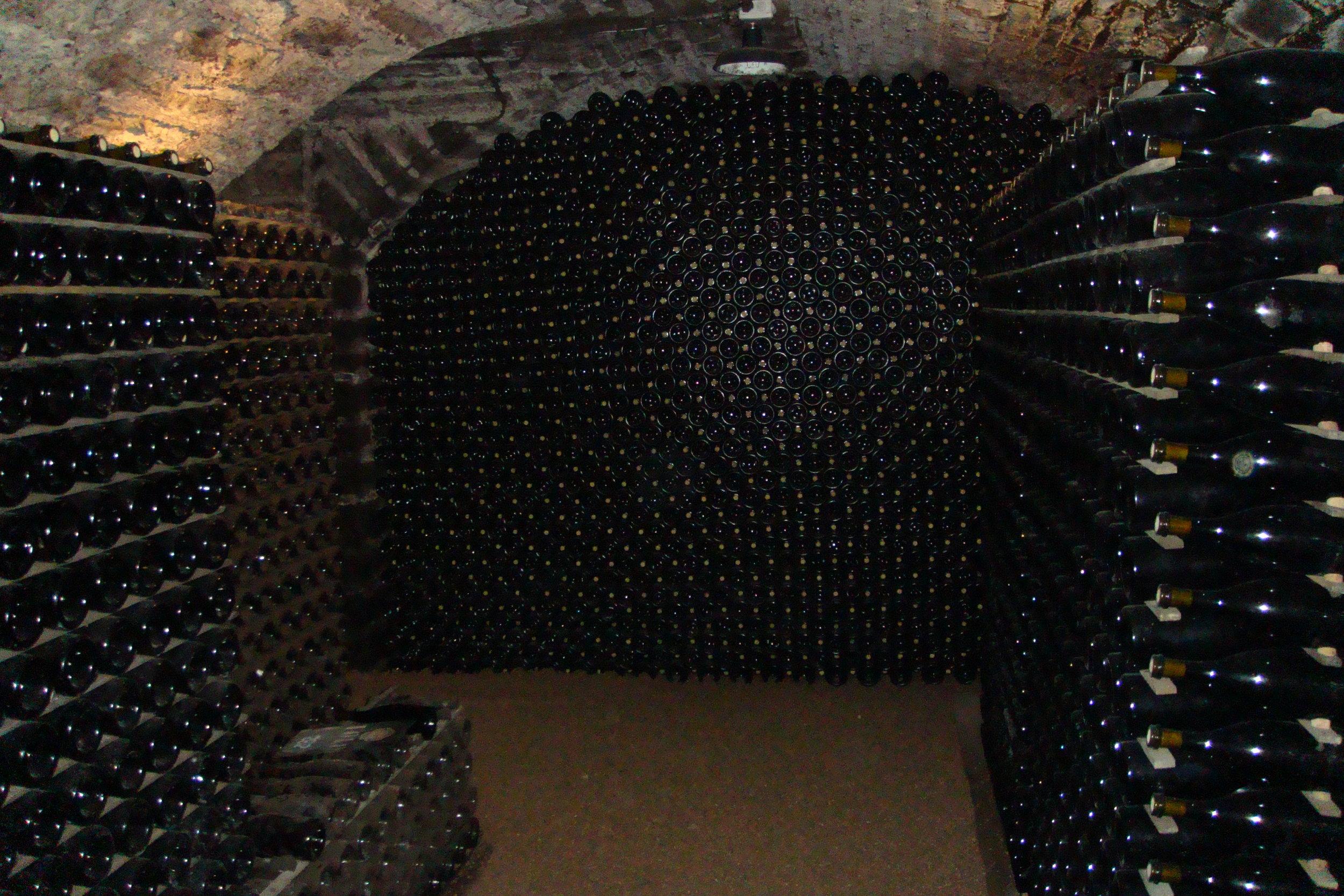 Burgundy_wine_aging_in_wine_cave.jpg