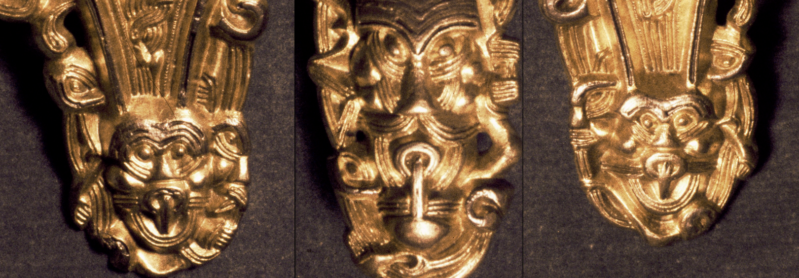 Detail of mask ornaments on a Migration Era brooch from Fonnås, Norway.  See the whole thing here