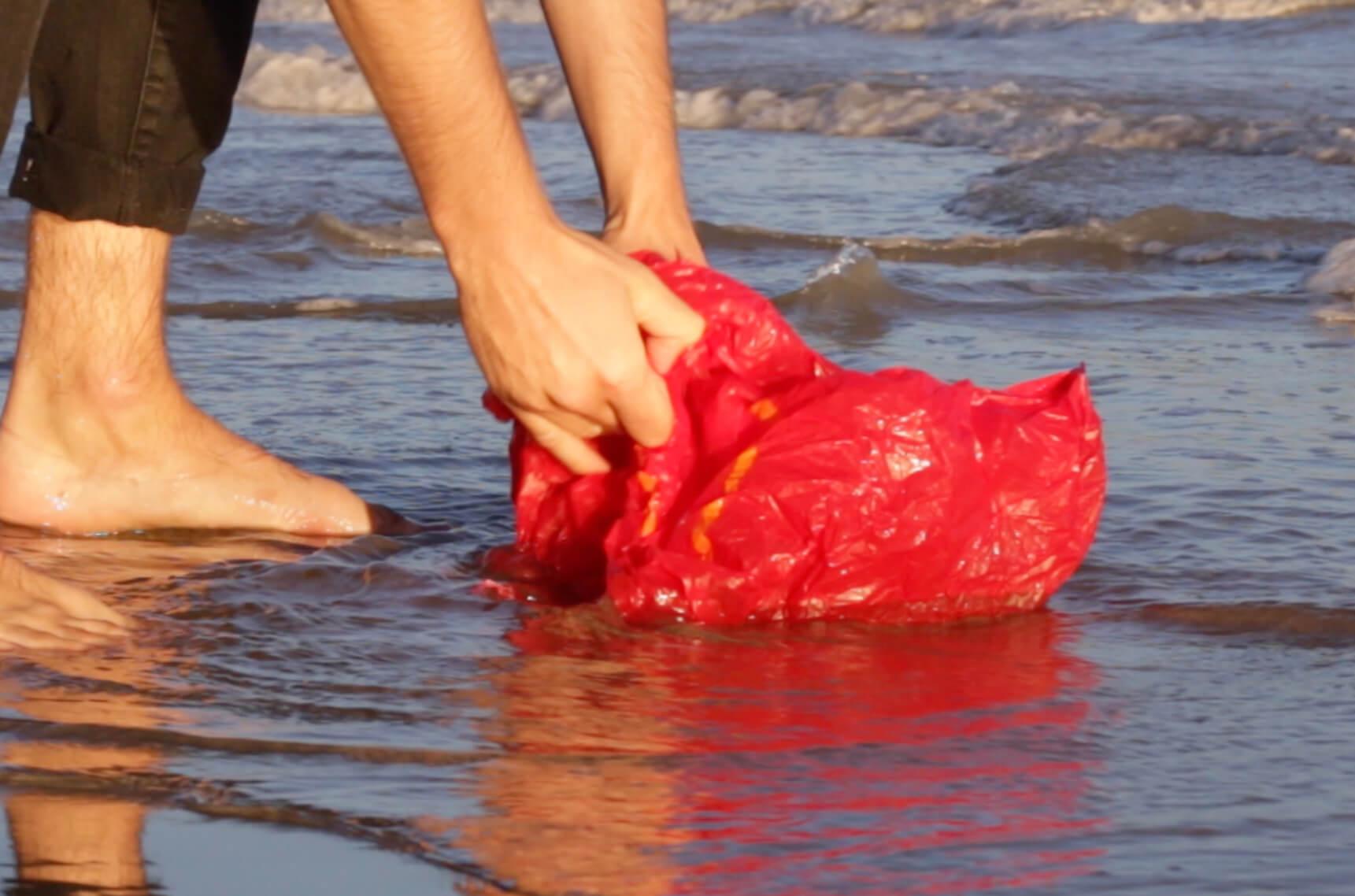 Gomi collecting plastic waste.jpg
