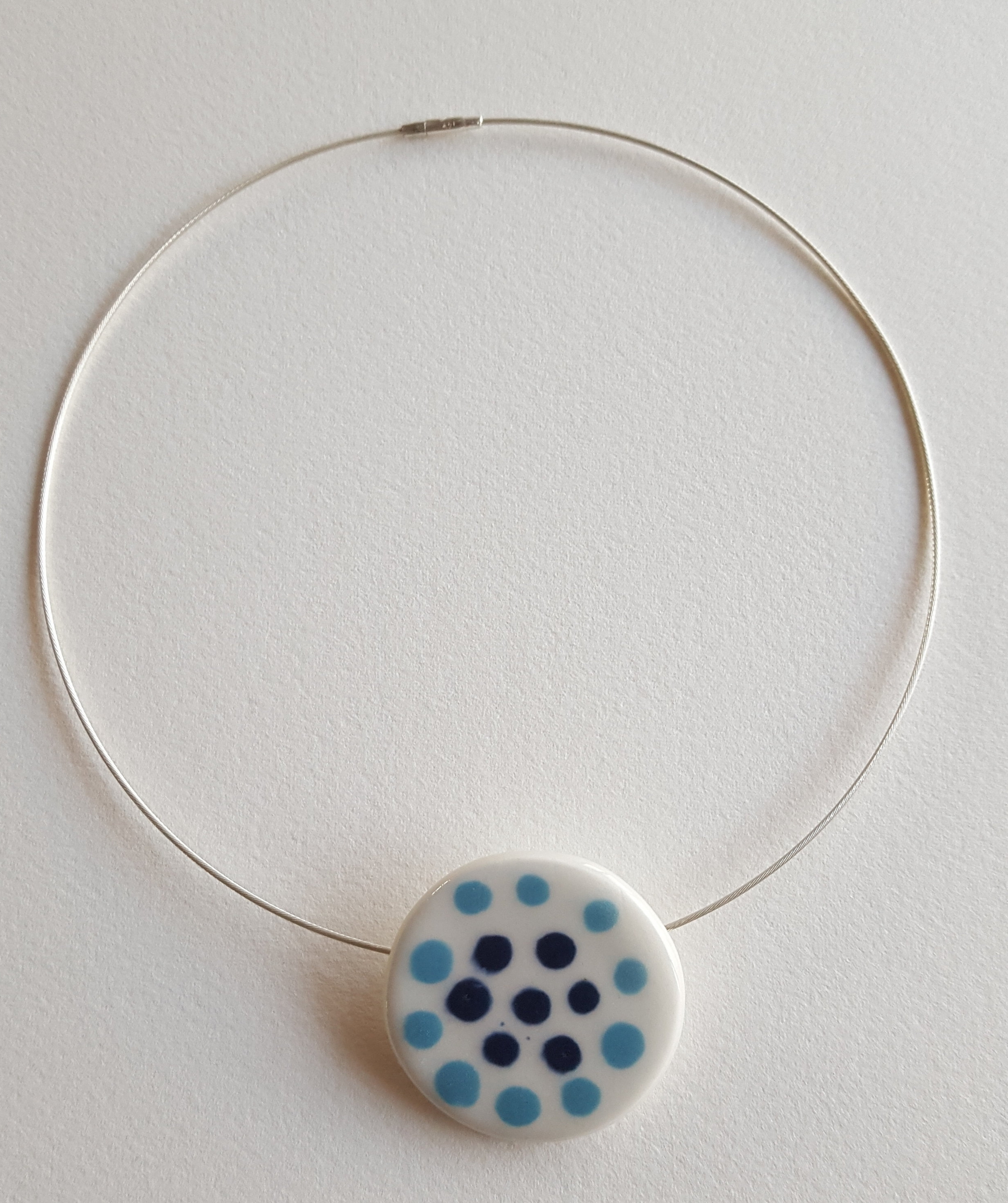 Porcelain Slip decorated disk on Sterling silver neck wire