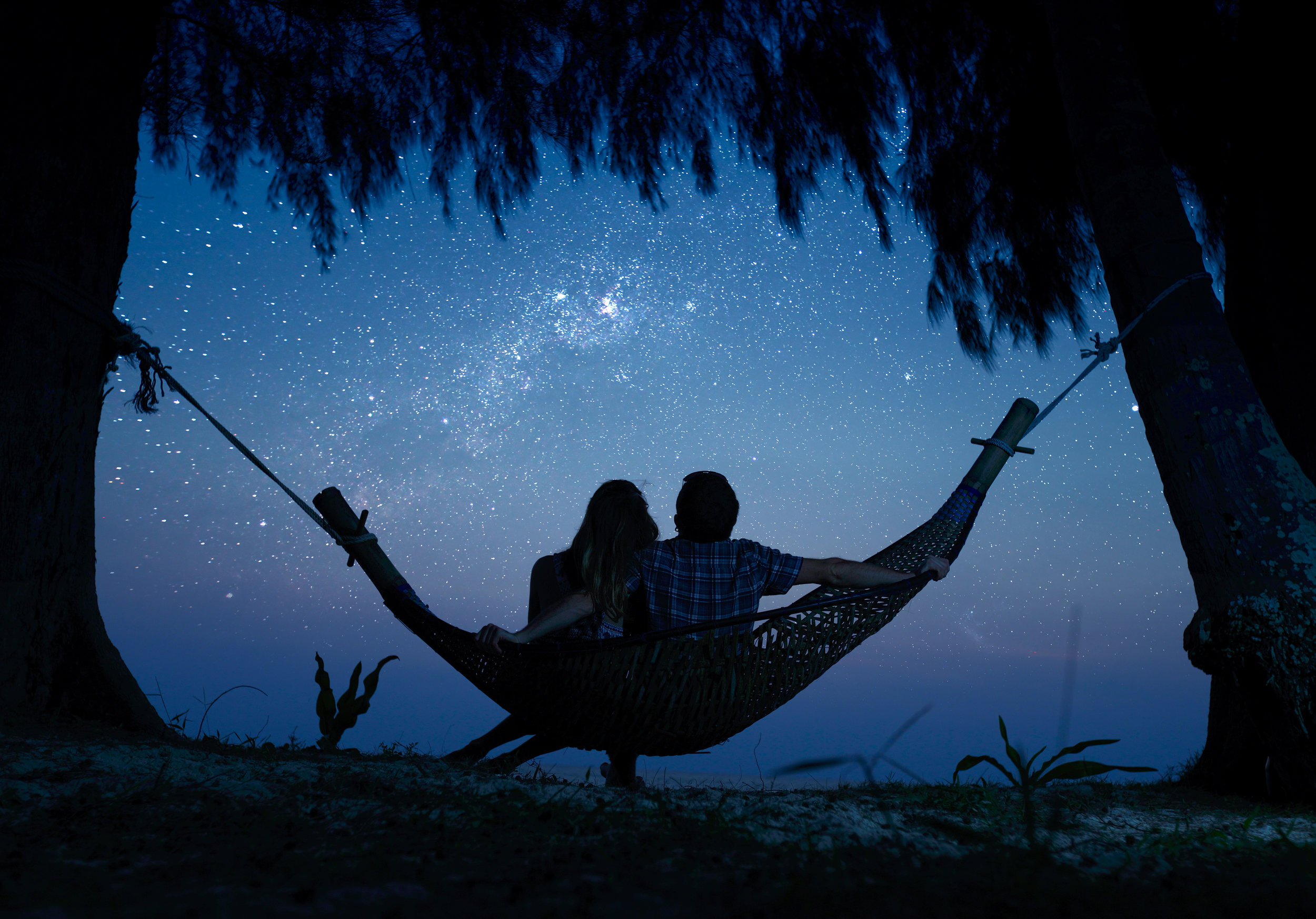 bigstock-couple-relaxing-in-a-hammock-a-61475849.jpg