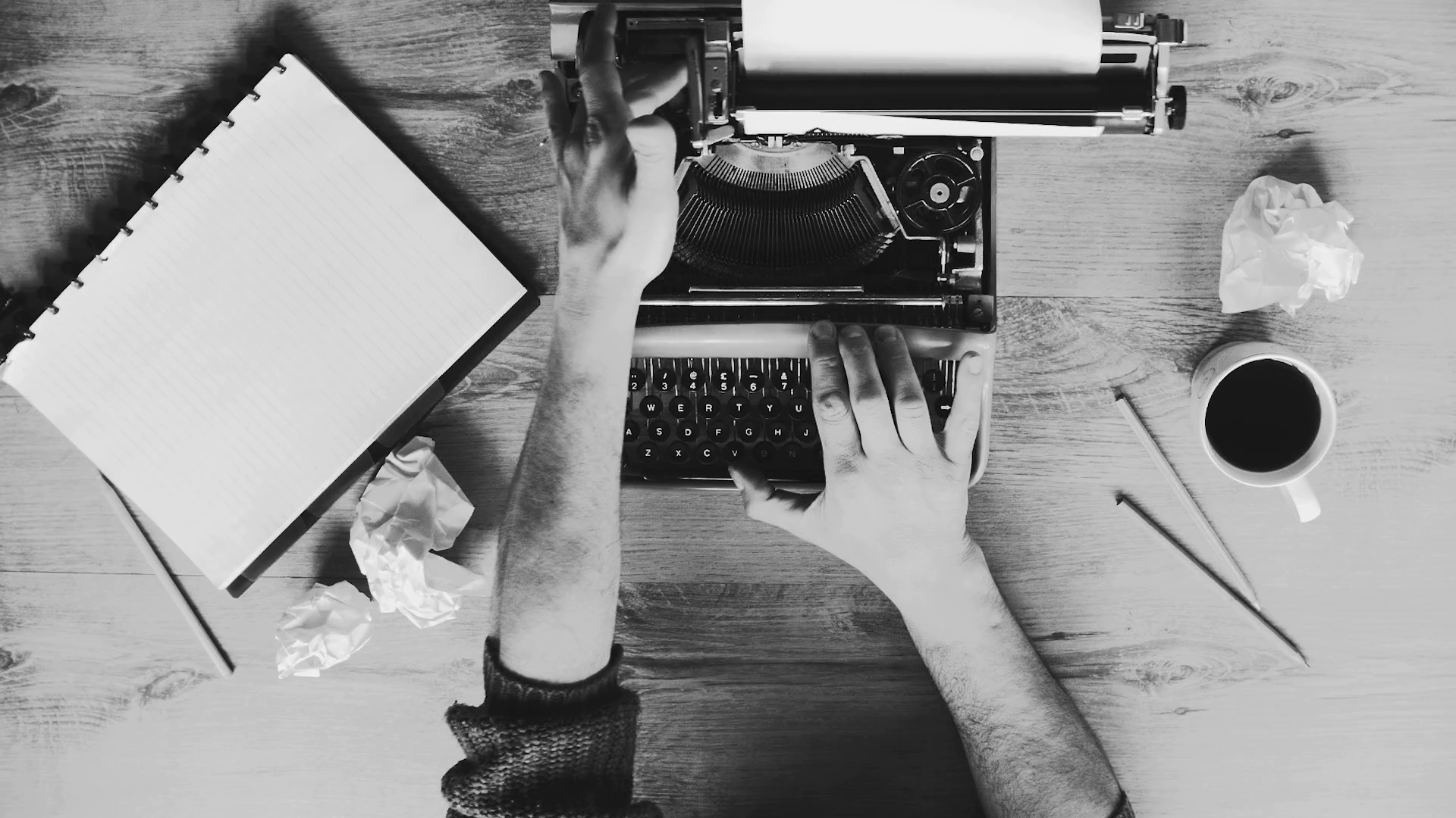 black-and-white-artistic-shot-of-hands-typing-on-a-vintage-typewriter-space-for-writing-film-script-book-or-letter_b5ca8rr_x_thumbnail-full01.png