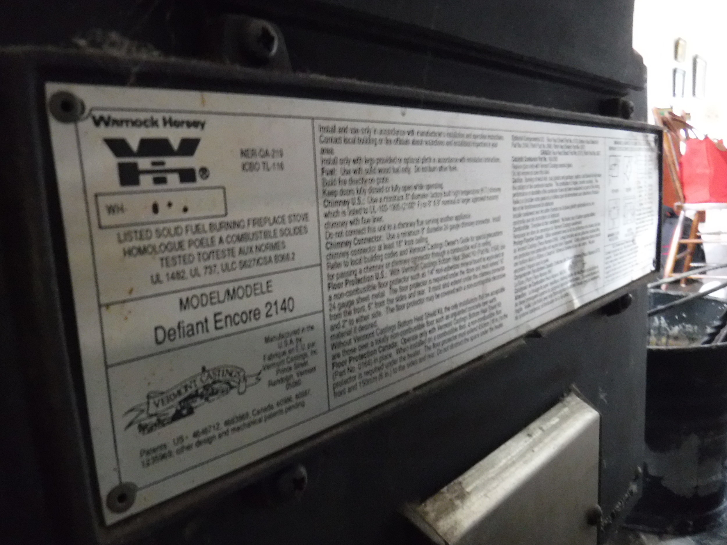 Certification sticker on the back of a wood stove