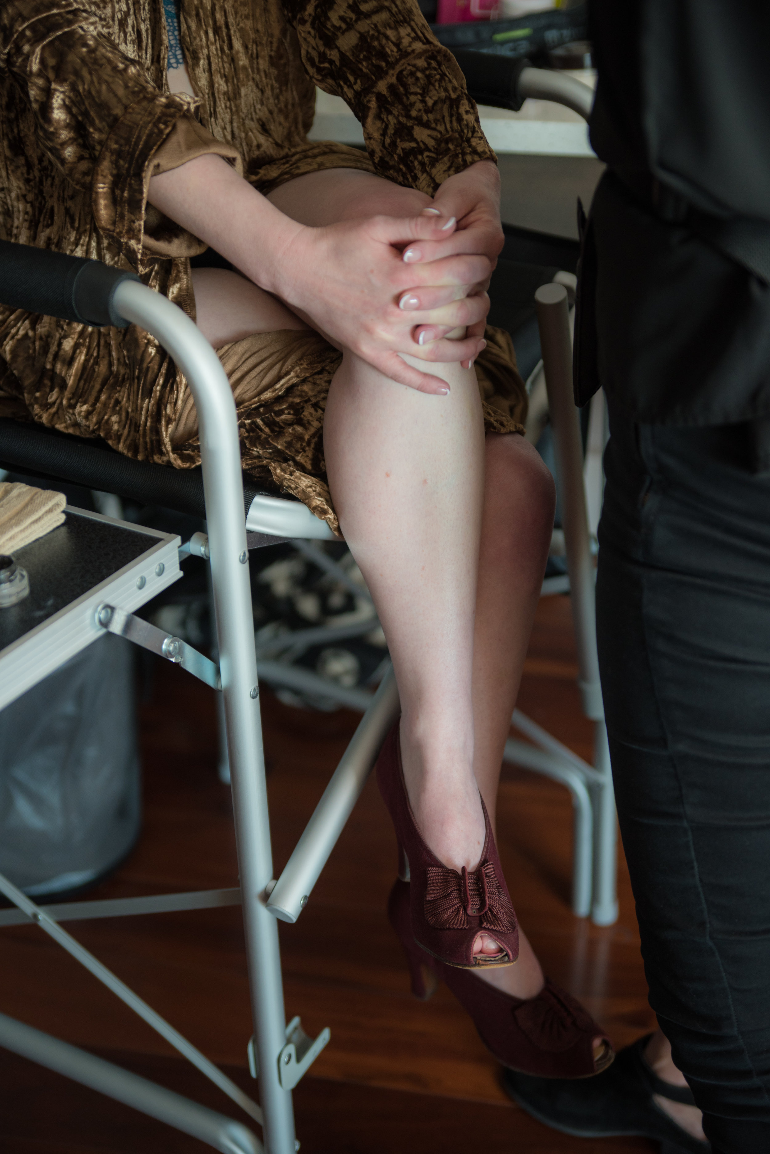 Montford Rooftop Bar_Styled Elopement_AEP-15 just bloom together with vintage shoes in chair getting make up done.jpg