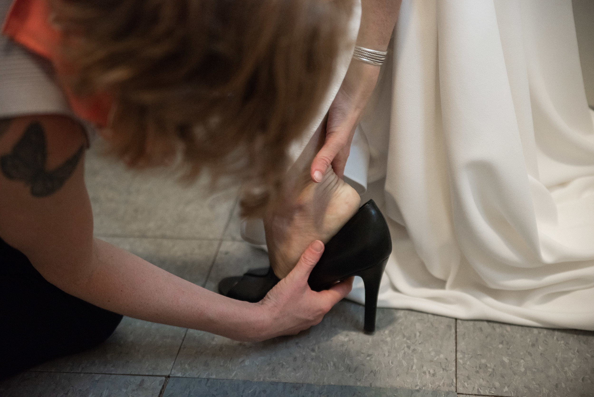 Salvage Station Styled Shoot_ AEP-188  em helps put lauren shoes on.jpg