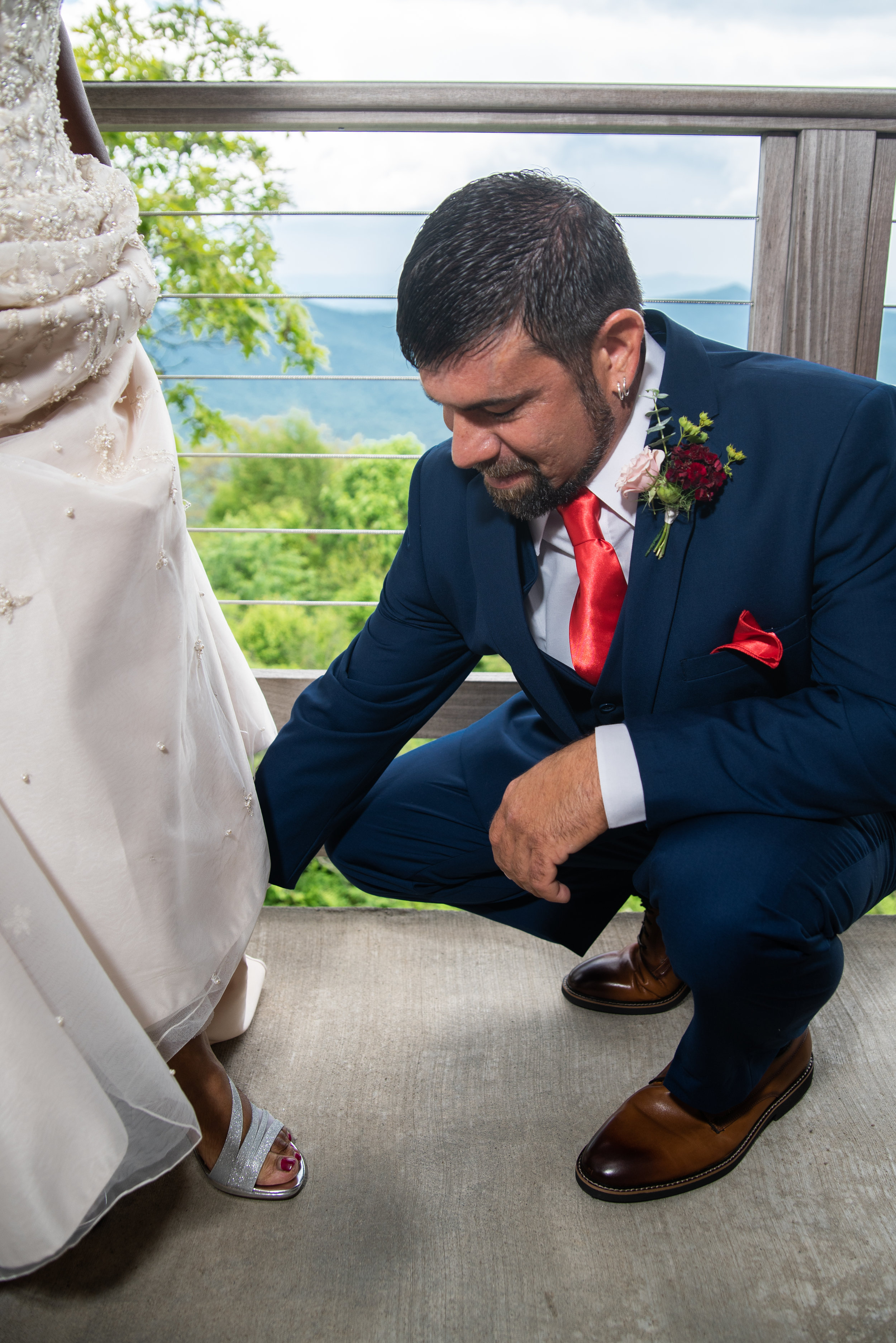 KeyaEric_Elopement-62 eric puts on her shoes adrian etheridge photography just bloom together styling.jpg