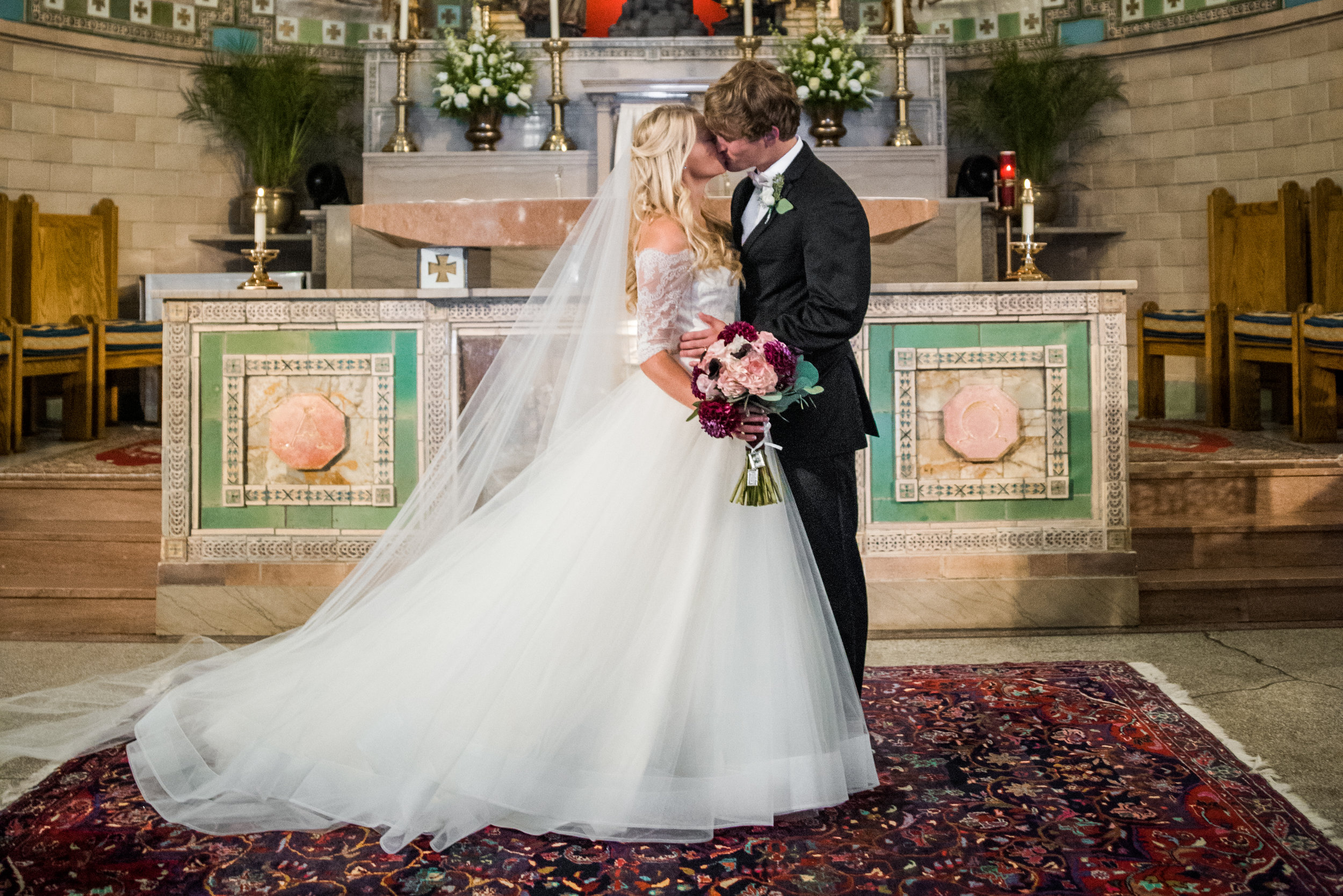 First Kiss at St. Lawerence Basilica in Asheville, NC