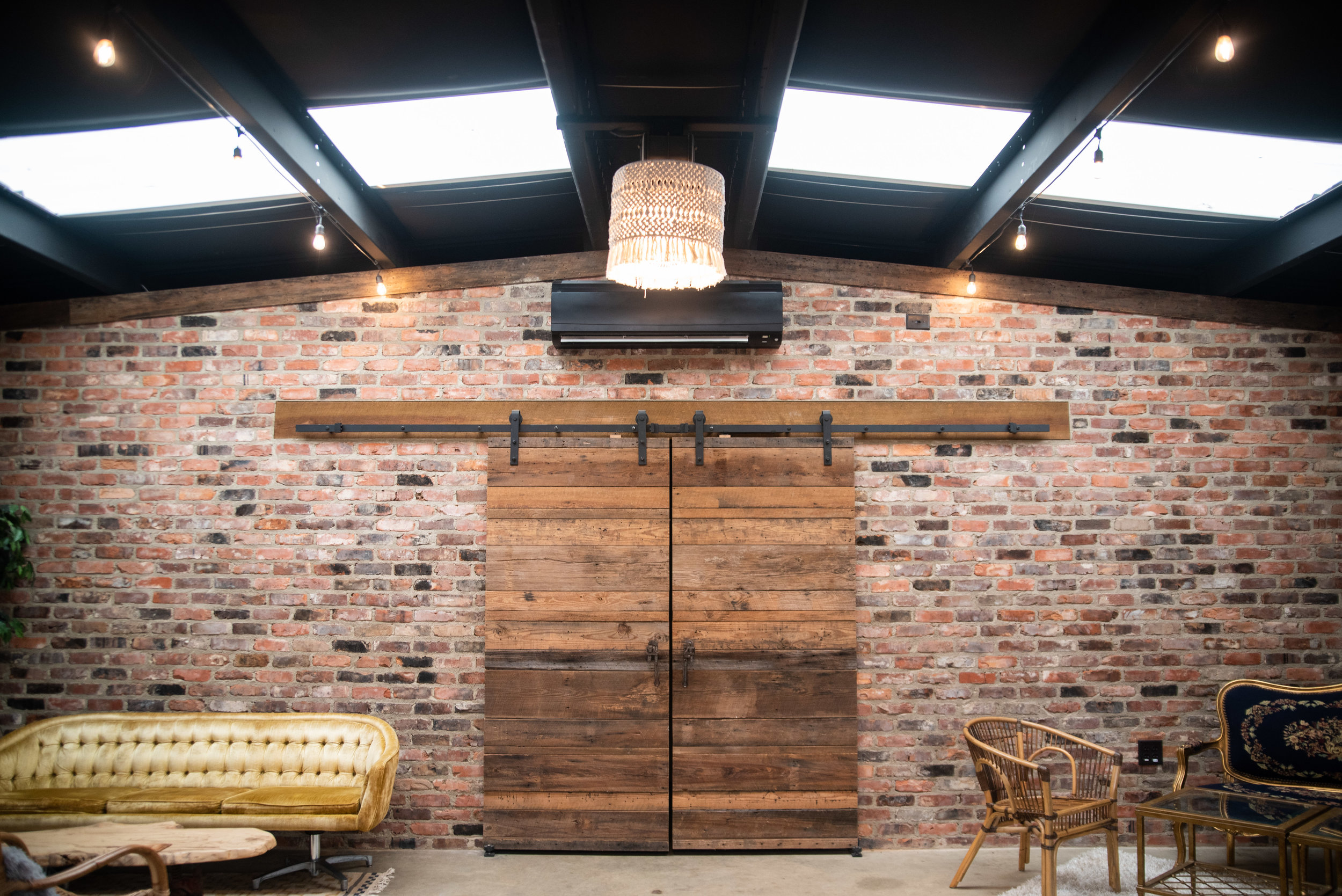 The Meadows Lounge area with barn doors in Raleigh, NC