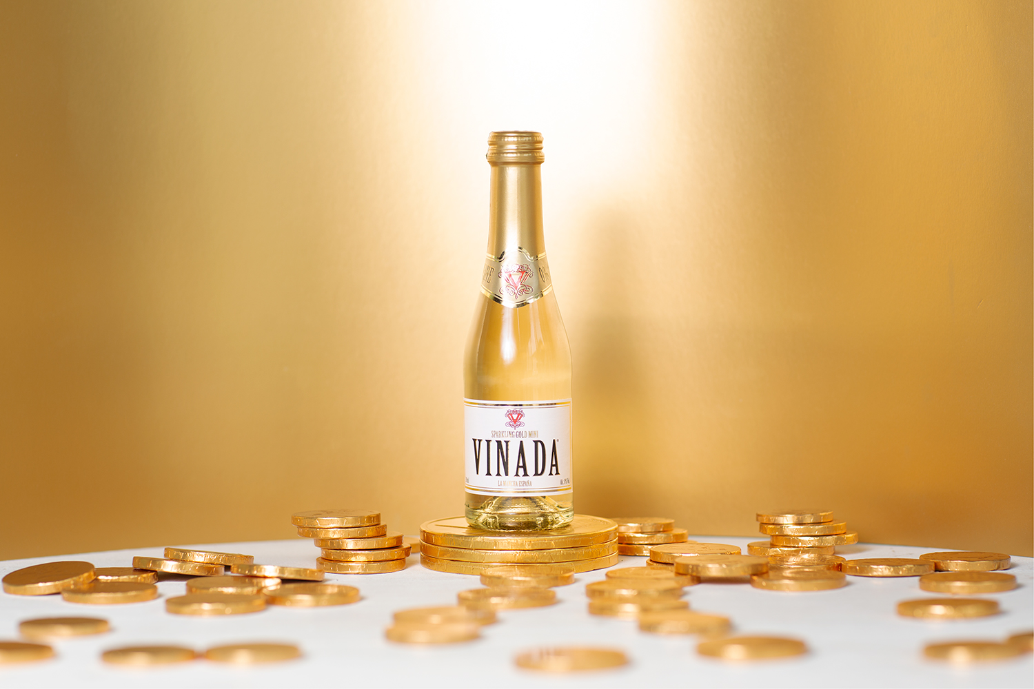 a bottle of vinada with confetti.