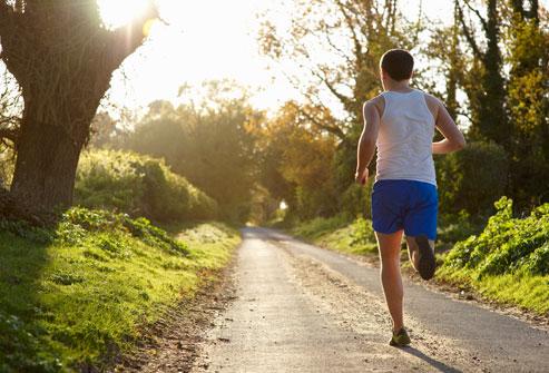getty_rf_photo_of_man_jogging_in_woods.jpg
