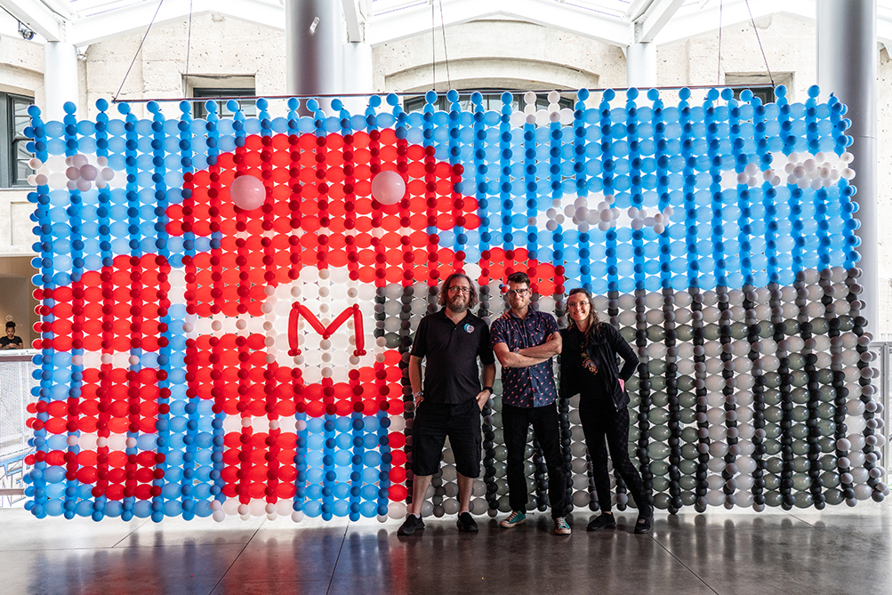 Larry Moss, Dave Brenn, and Danielle Payne in Kansas City, standing in front of a bubble mural created by a team of more than a dozen Maker Faire Volunteers that worked with hundreds of community participants.