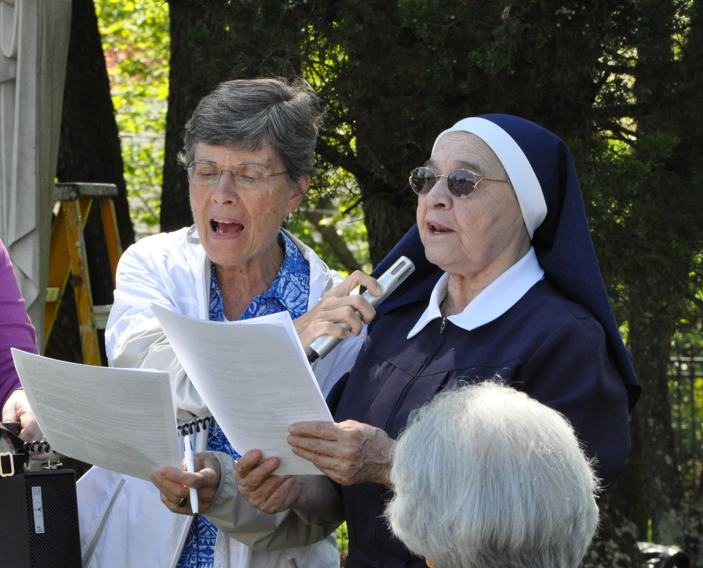 Sister Ines Gizzarelli  and  Sister Margarita Bermudez  singing a hymn during the crowning of Our Lady's statue