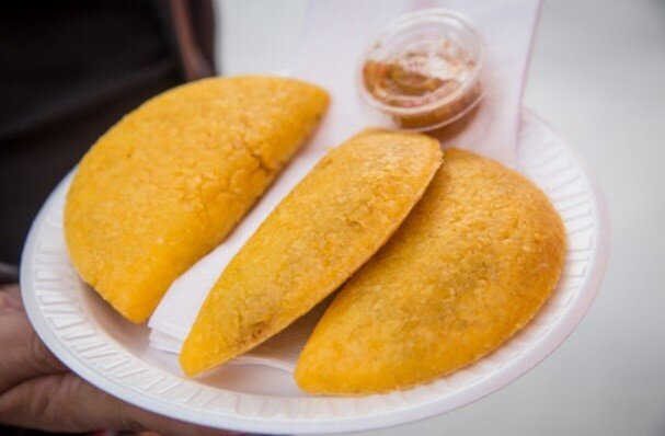 - Offers a wide variety of Colombian food. Enjoy an amazing bandeja paisa, empanadas, arepas, chorizos, patacones, cholaos and much more. All Colombian traditional cuisine in one place for you to try with the characteristic Colombian environment.