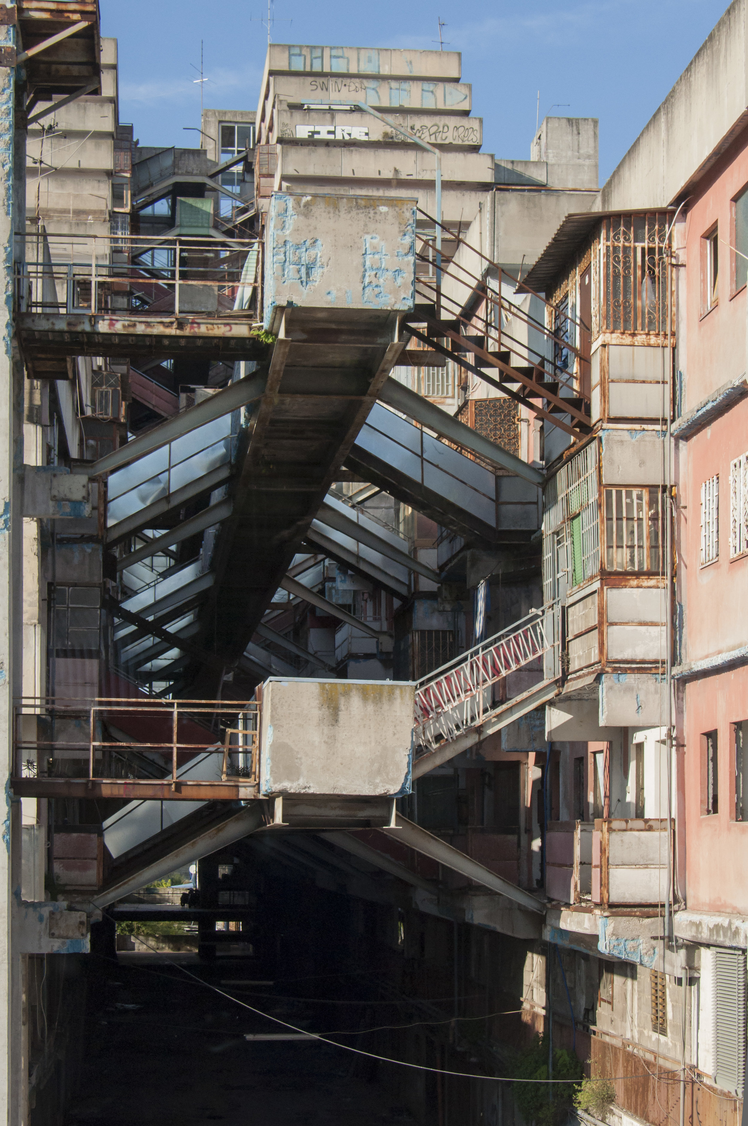 The intricate connecting stairs. Details of the Sails of Scampia in the Secondigliano district. Naples, Italy.