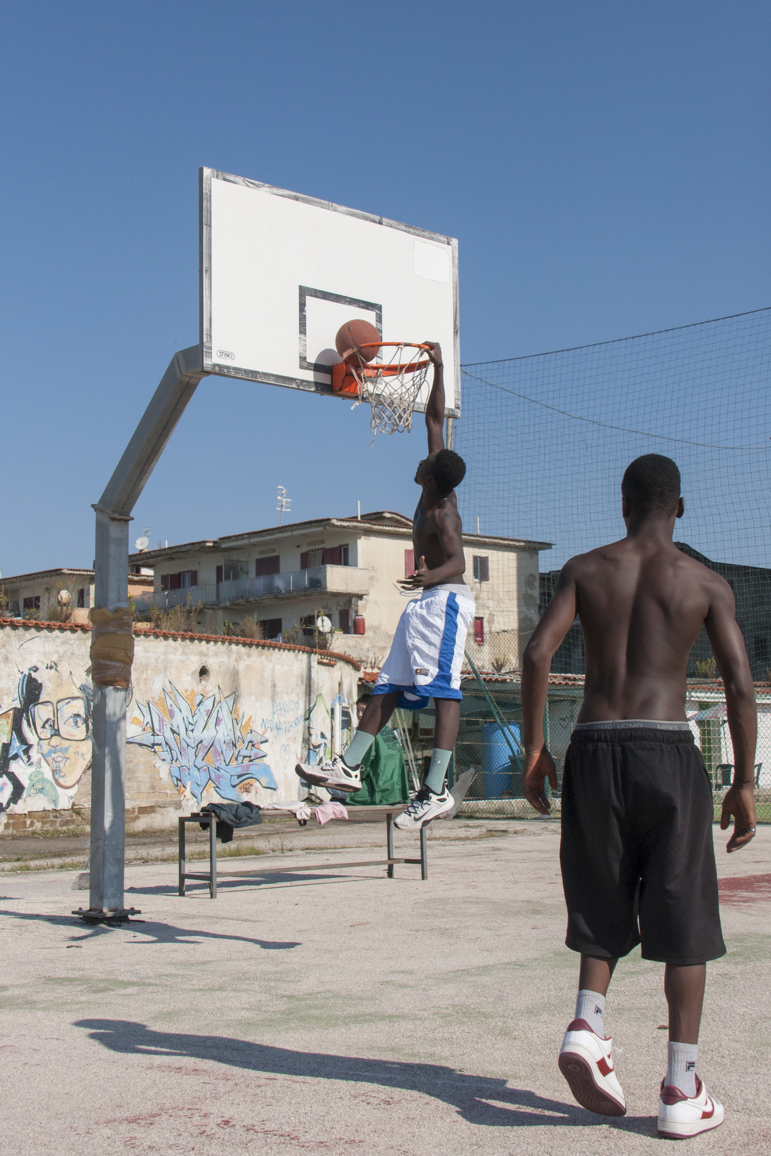 Practice makes perfect: James, a member of the Tam Tam Basket, making a dunk. Castel Volturno. Naples, Italy