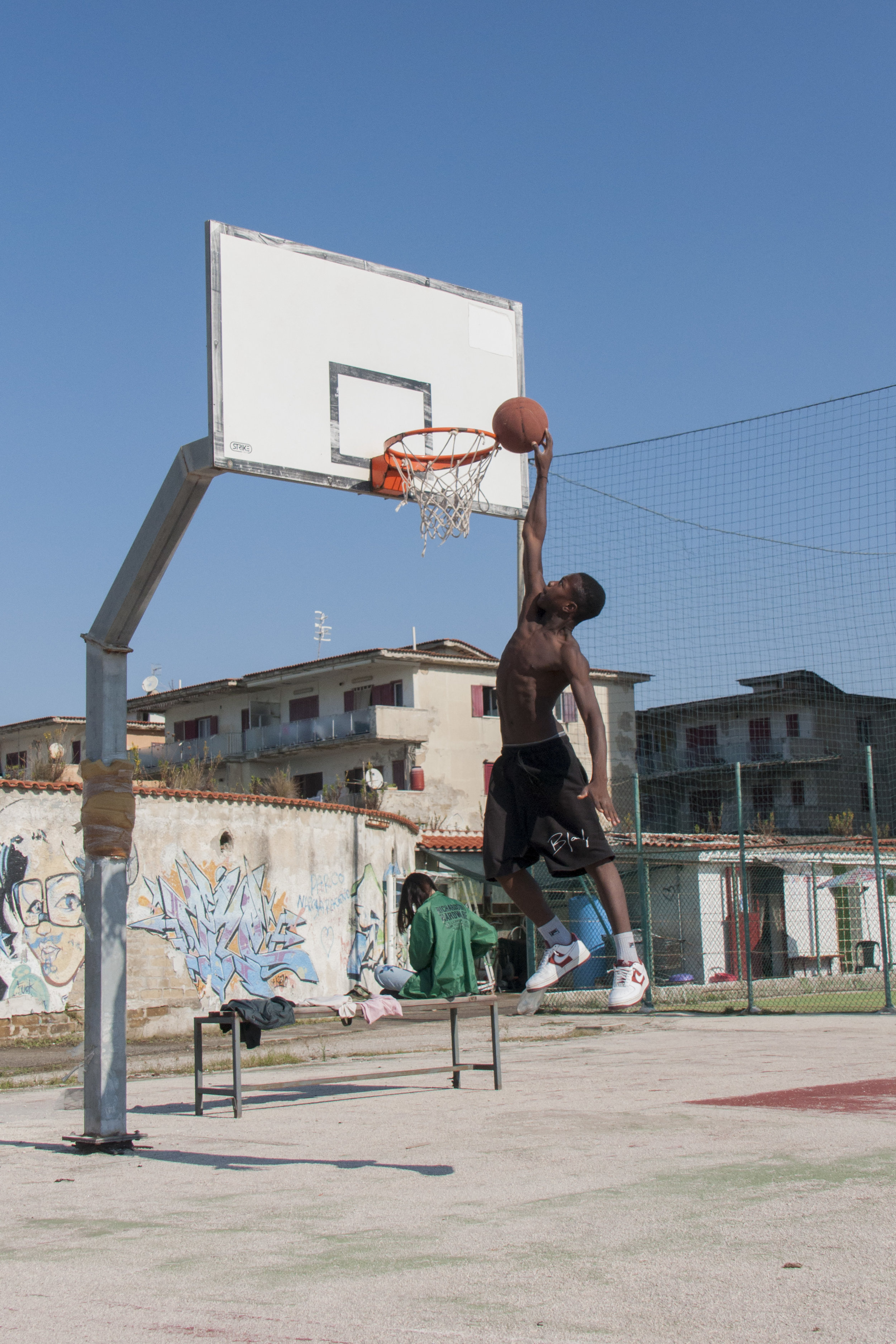 Practice makes perfect: Miracolo, a member of the Tam Tam Basket, attempting a dunk. Castel Volturno. Naples, Italy.