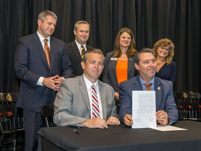 Photo caption: Seated, from left: PMC CEO Donovan Blackburn and UPIKE President Burton J. Webb, Ph.D. Standing, from left: Kentucky Sen. Ray S. Jones II, Pikeville City Manager Philip Elswick, UPIKE Provost Lori Werth, Ph.D., and PMC Radiation Oncologist Ruth Lavigne, M.D.