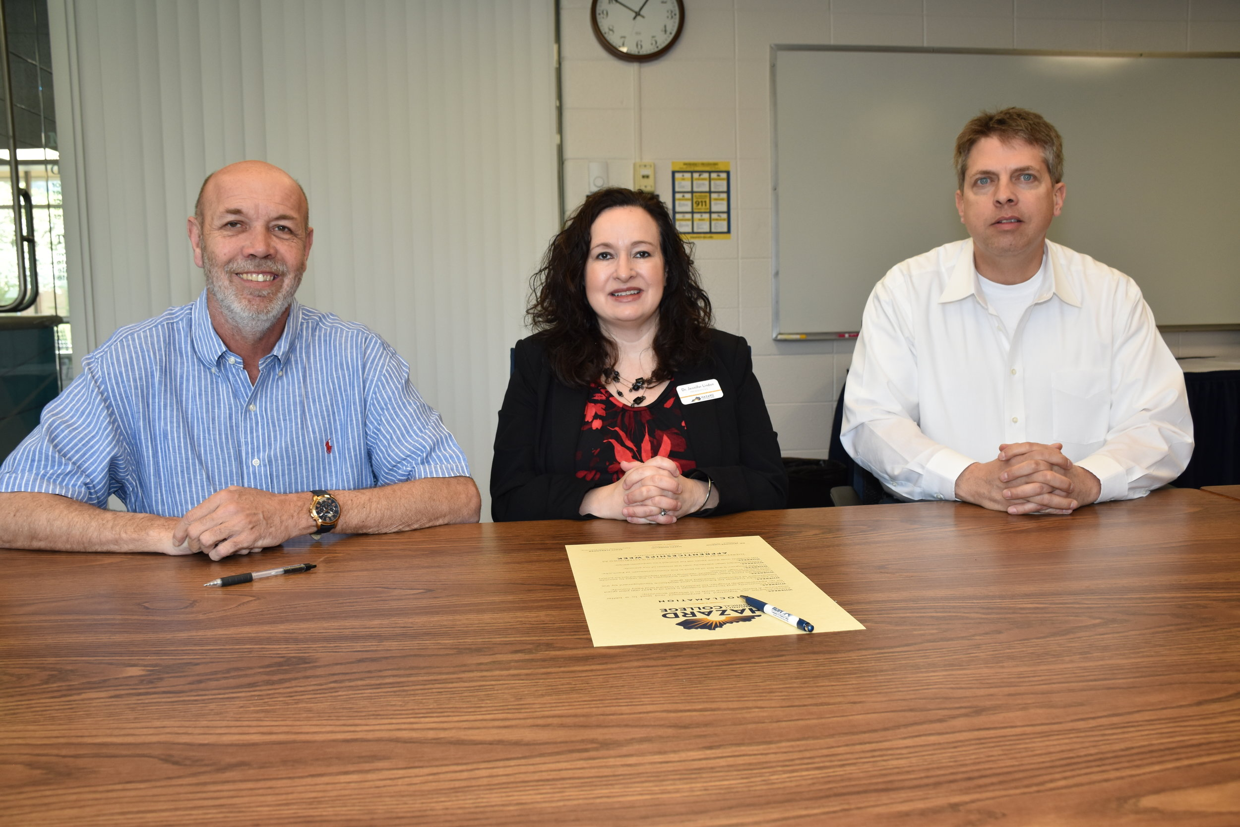 May 6-11 is declared as Apprenticeships Week in Hazard and Perry County. A signing ceremony was held, with signatures from Hazard Mayor Happy Mobelini, Hazard Community and Technical College President Dr. Jennifer Lindon, and Perry County Judge Executive Scott Alexander. A grant is being awarded to create an apprenticeship program for high school students in Hazard and Perry County. Hazard Community and Technical College, in partnership with Juniper Health, Appalachian Regional Healthcare, University of Kentucky, Hazard Independent School System, and Perry County School System, will create an apprenticeship pathway, beginning in ninth grade and culminating in paid apprenticeships for juniors and seniors in high school