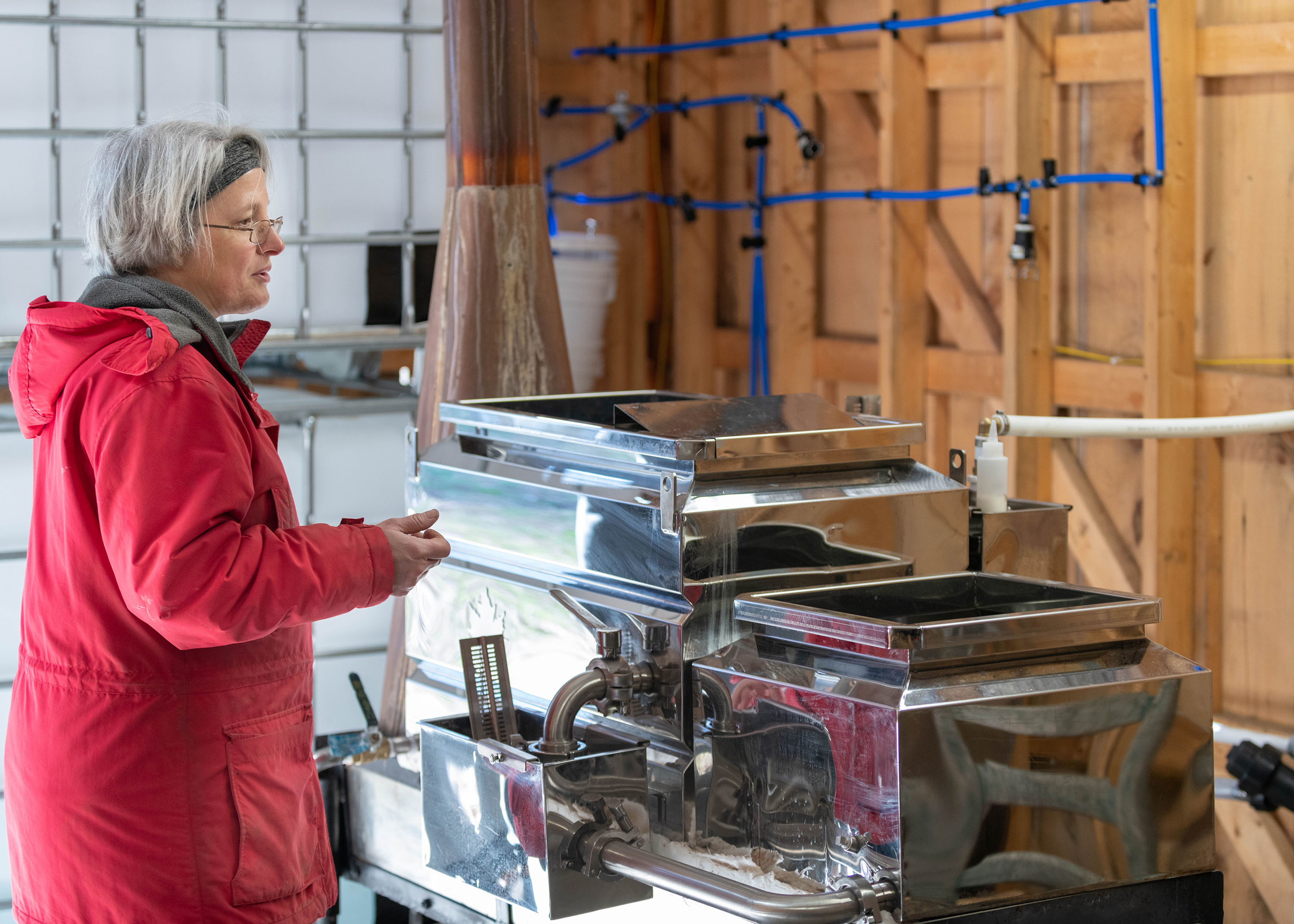 SouthDown Farm's Sheryl Long demonstrates how the sap is turned into syrup using the evaporator.