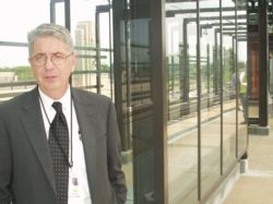 Mike Setzer at the Lake Street LRT station, May 2004. Setzer will leave Metro Transit soon after the debut of Hiawatha light rail.