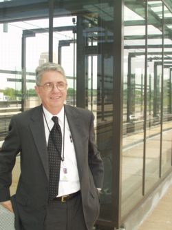 """There she is."" Mike Setzer awaits an incoming train at the Lake Street LRT station, May 2004"