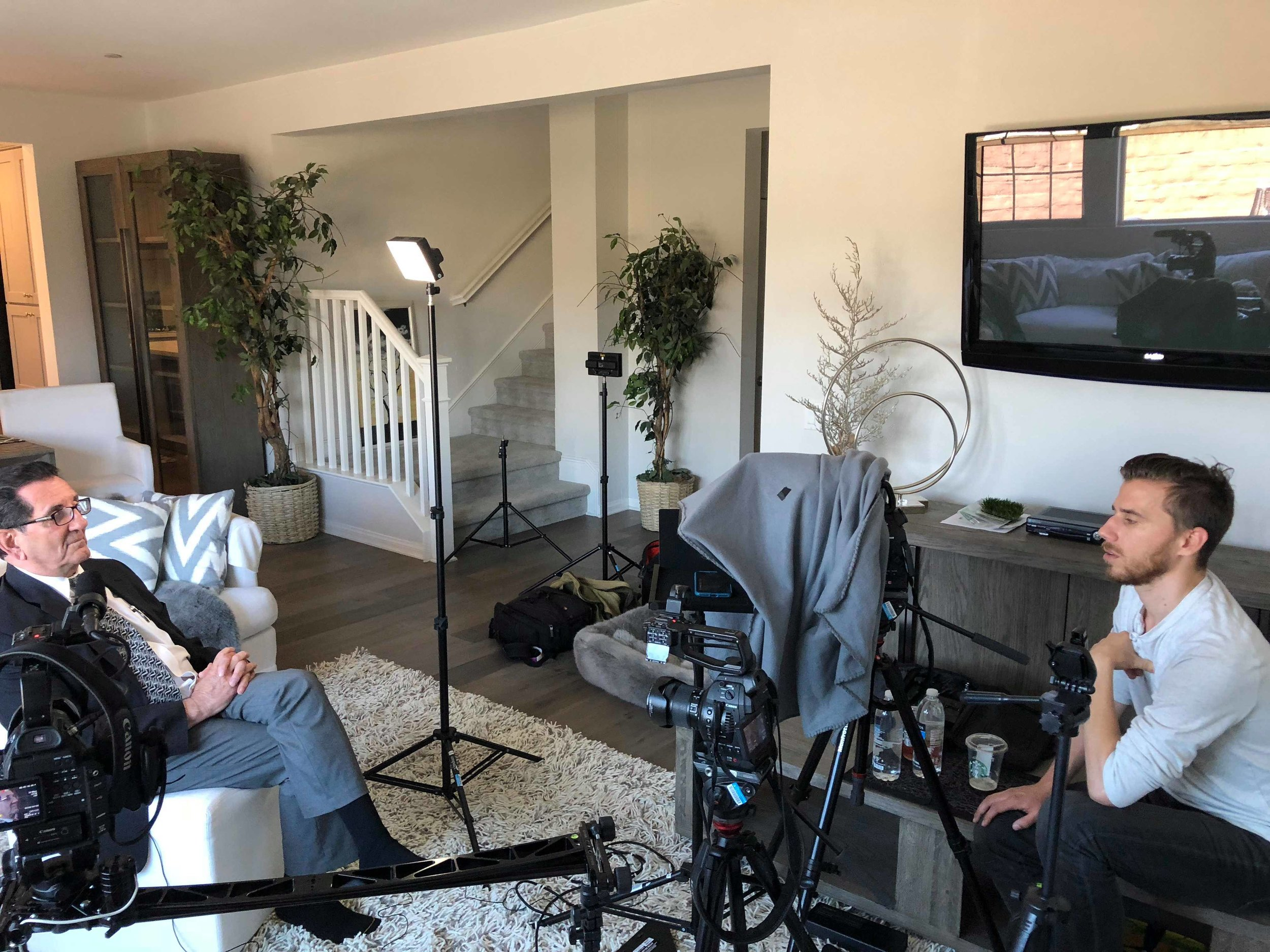 Director Daniel A. Nelson interviewing Louis Pilato about his experience defending Kim.