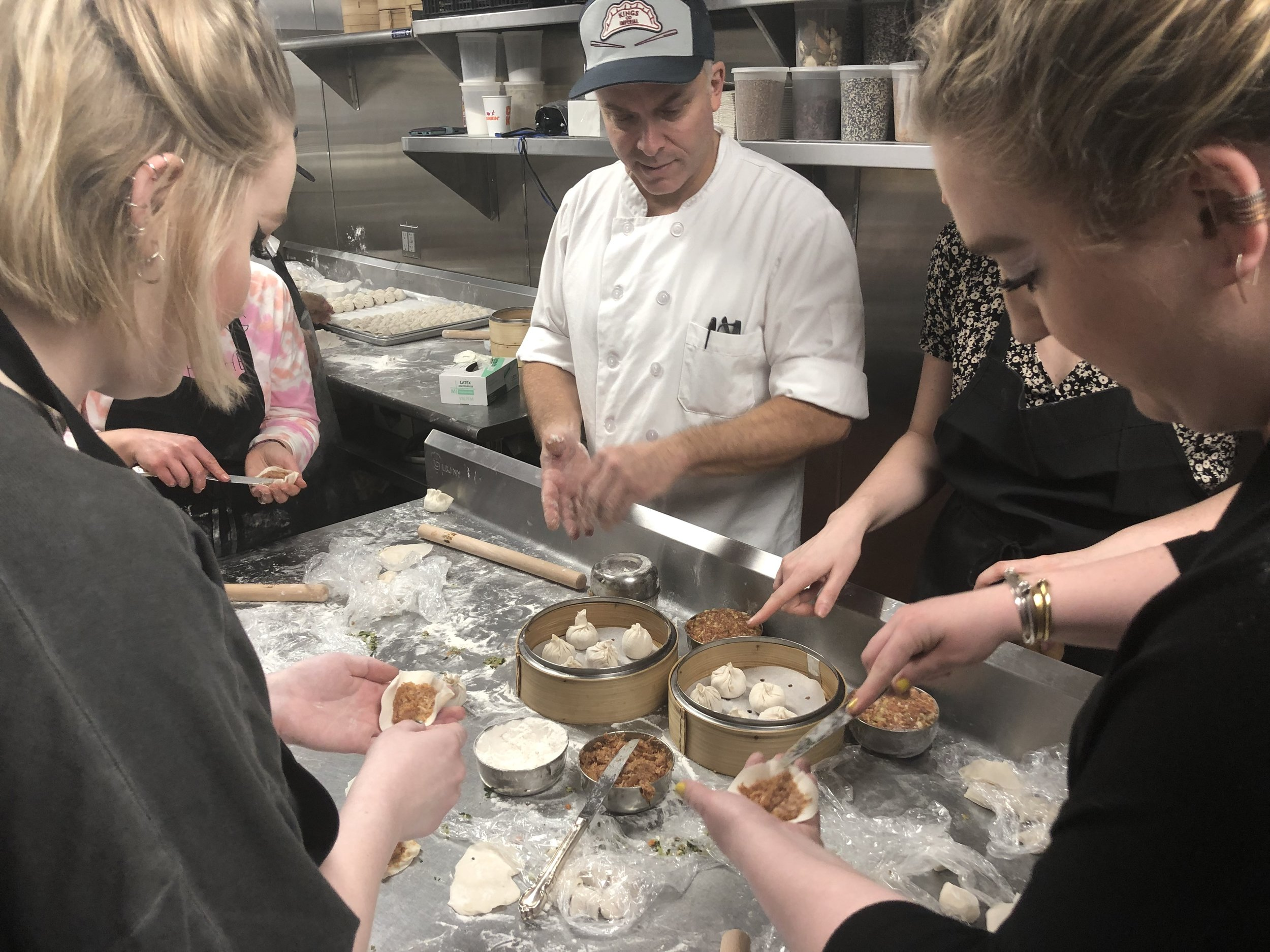 Josh Grinker teaching our Leisurely class the subtle art of stuffing dumplings. Photo: Leisurely
