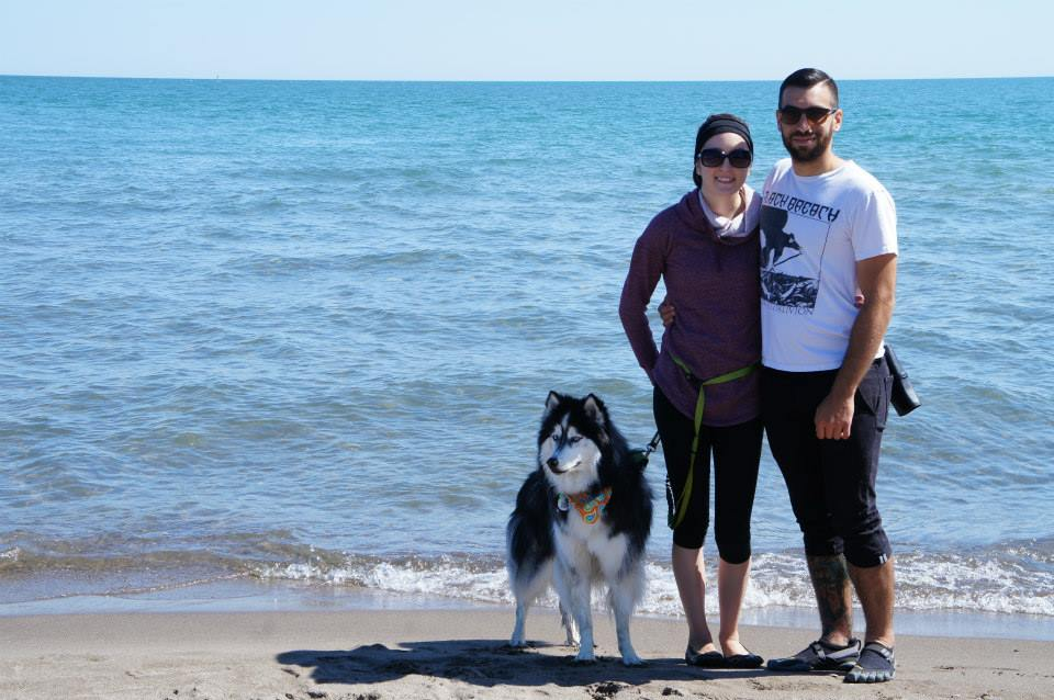 Katelyn, Marc and their Siberian Husky, Juneau, on the beach of Point Pelee National Park in Ontario, Canada