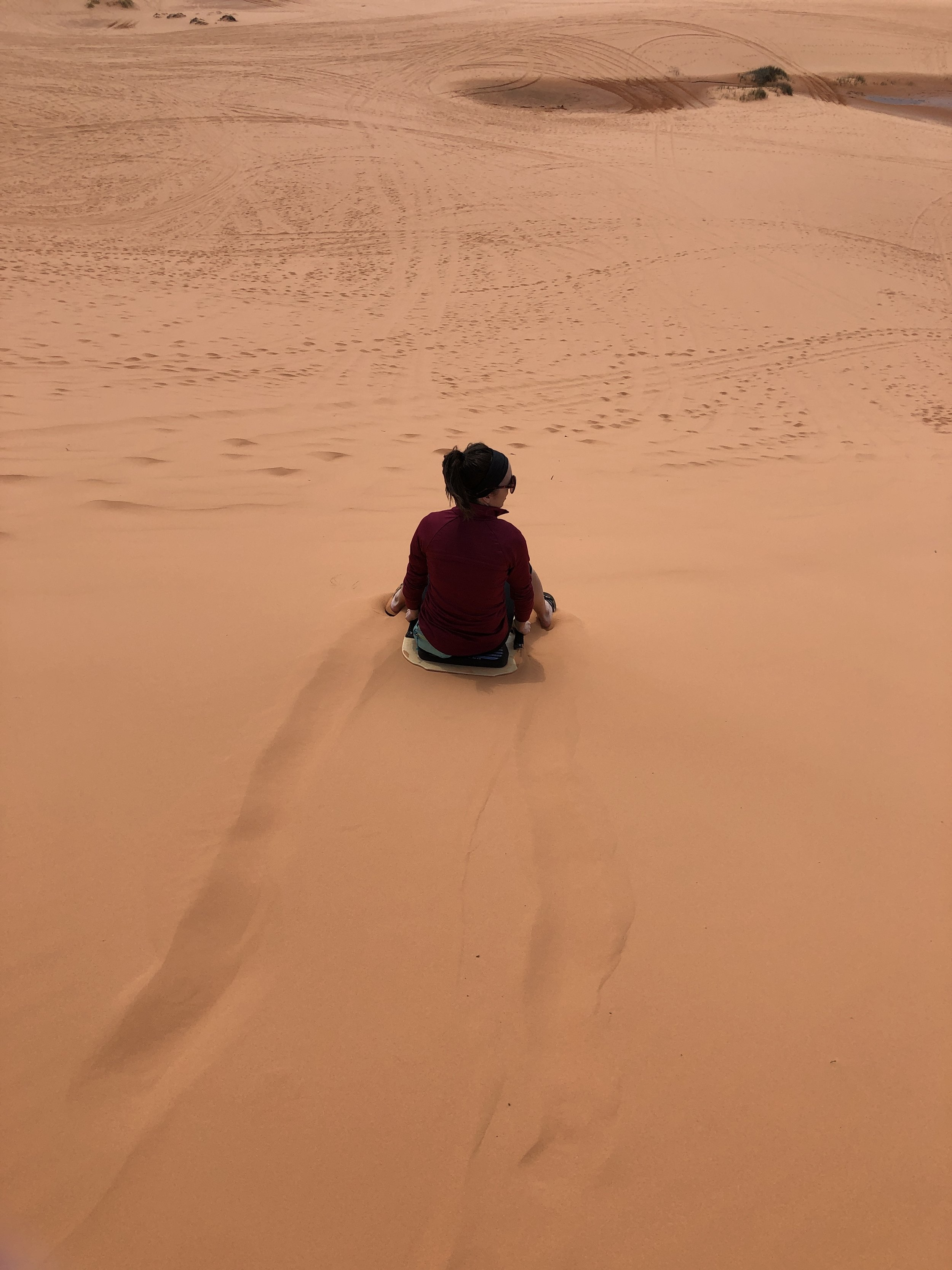 coral-pink-sand-dunes-sledding-out-office-adventure