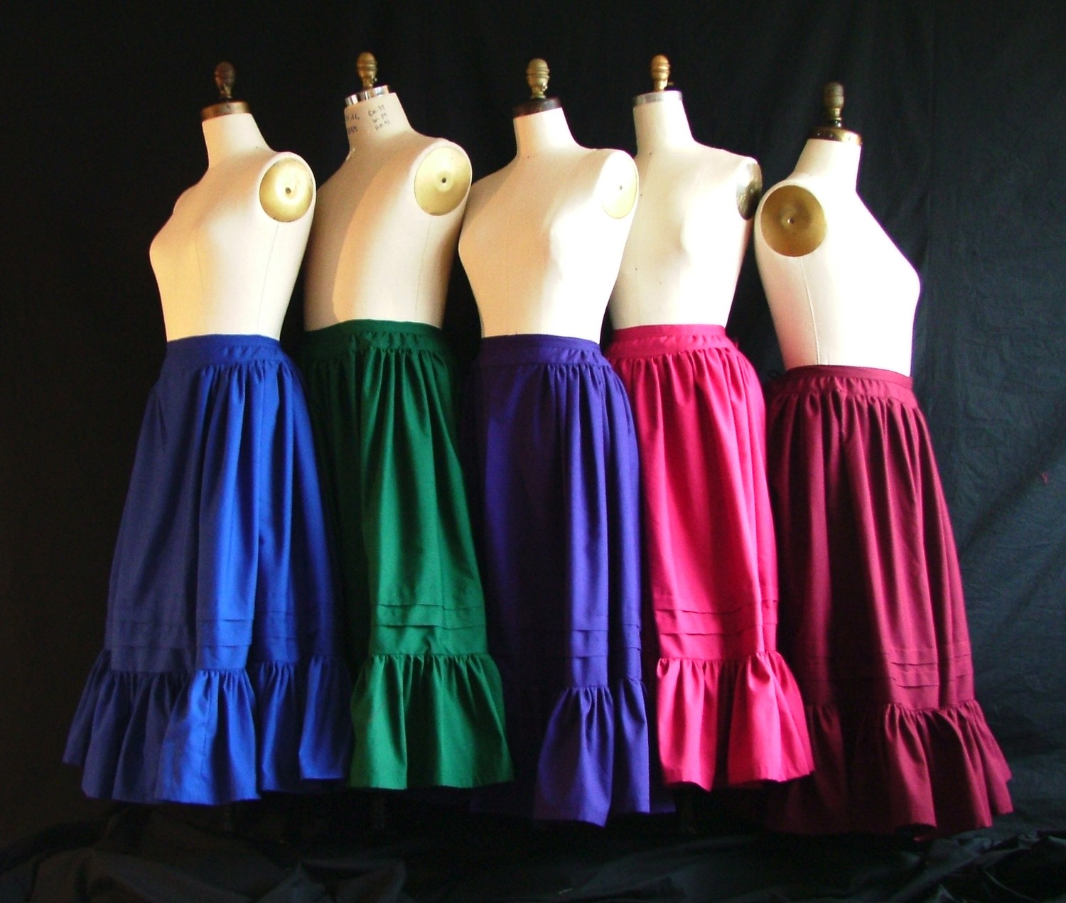 Any of our petticoat styles are available custom made in your own fabrics. Email for questions and details. Shown here, our Peasant Petticoats in a rainbow of Kona Cottons.