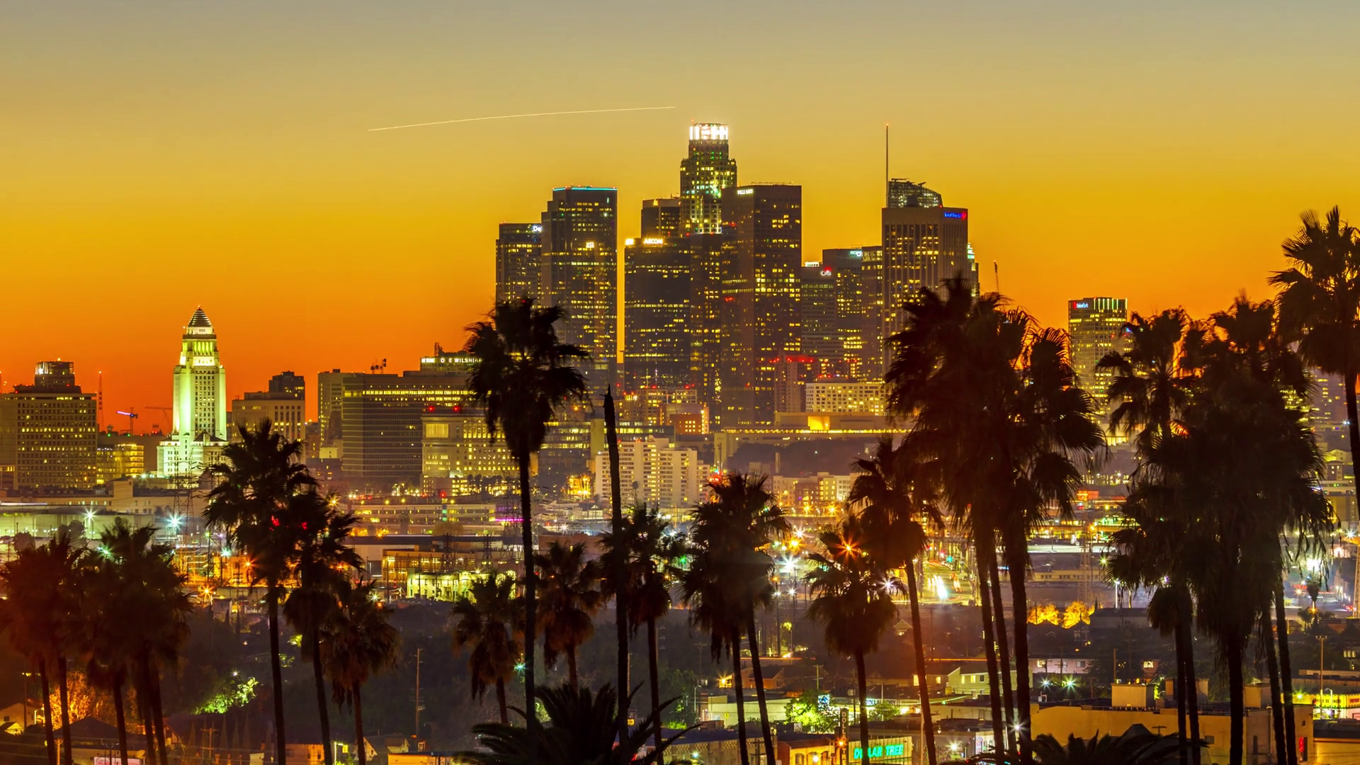 sunset-to-night-transition-zoom-out-of-city-of-los-angeles-downtown-skyline-with-palm-trees-silhouettes-in-foreground-4k-uhd-timelapse_bniwlnslg_thumbnail-full01.png