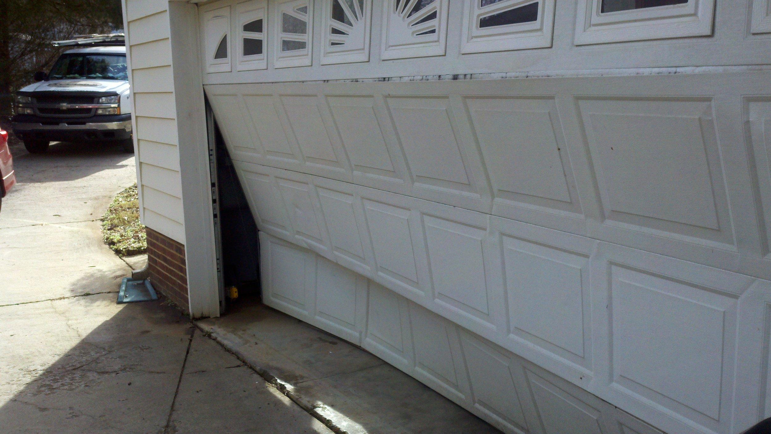 damaged_garage_door_sections.jpg