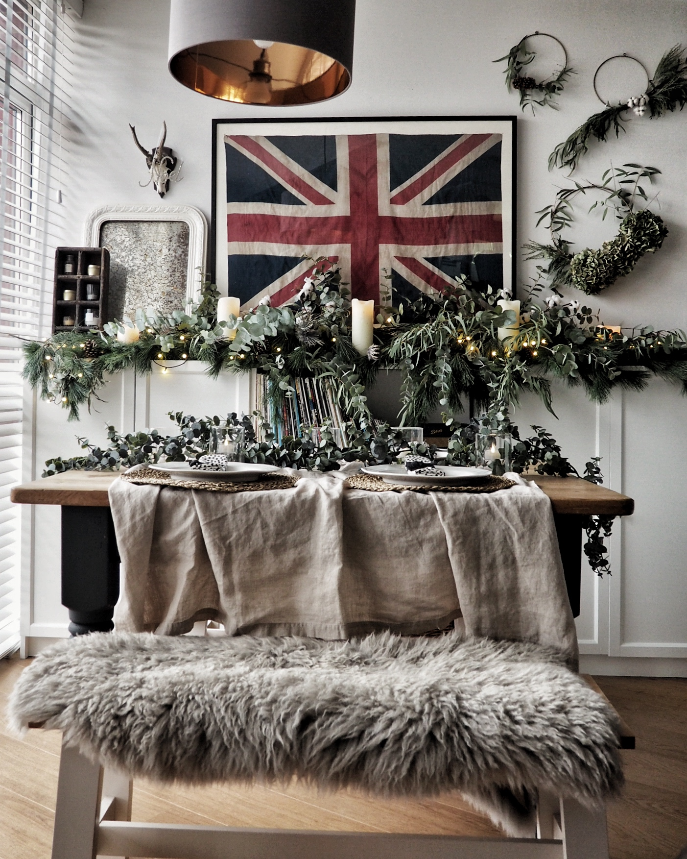 Faux eucalyptus garland used as table runner from Of Special Interest Interiors. Table cloth from H&M.