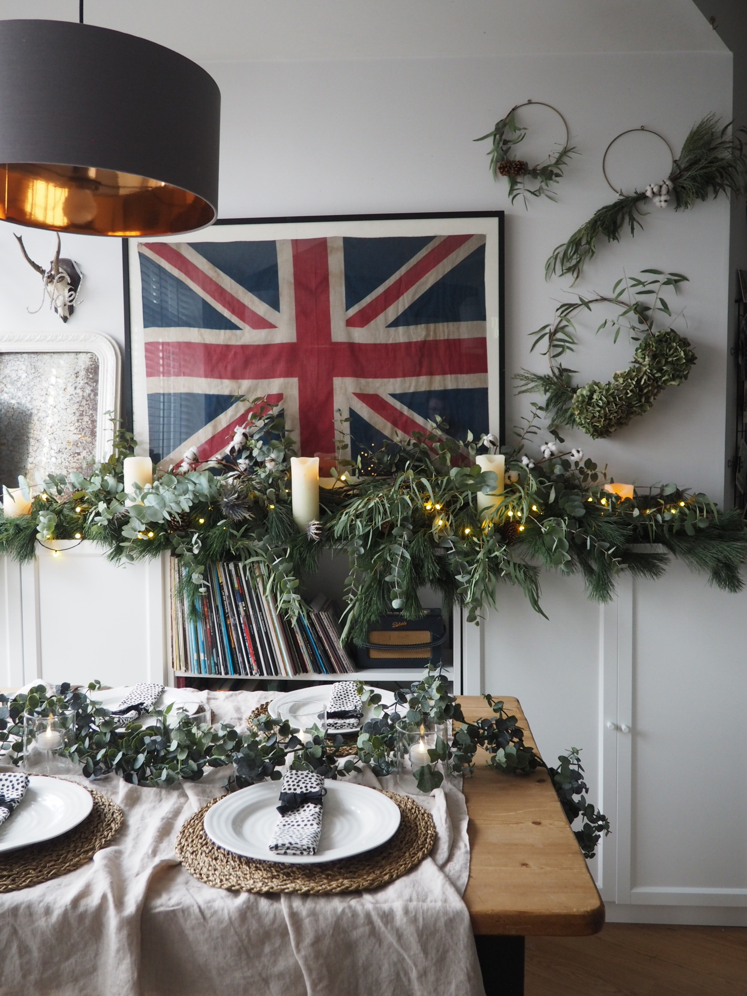 Brass wreath hoops from Curioegg and decorated using eucalyptus, fir tree clippings, dried hydrangeas and cotton buds (bought from Homesense).