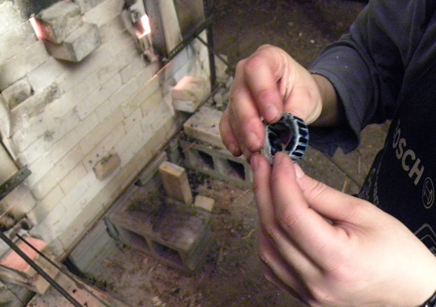 Checking the salt glaze on the ring