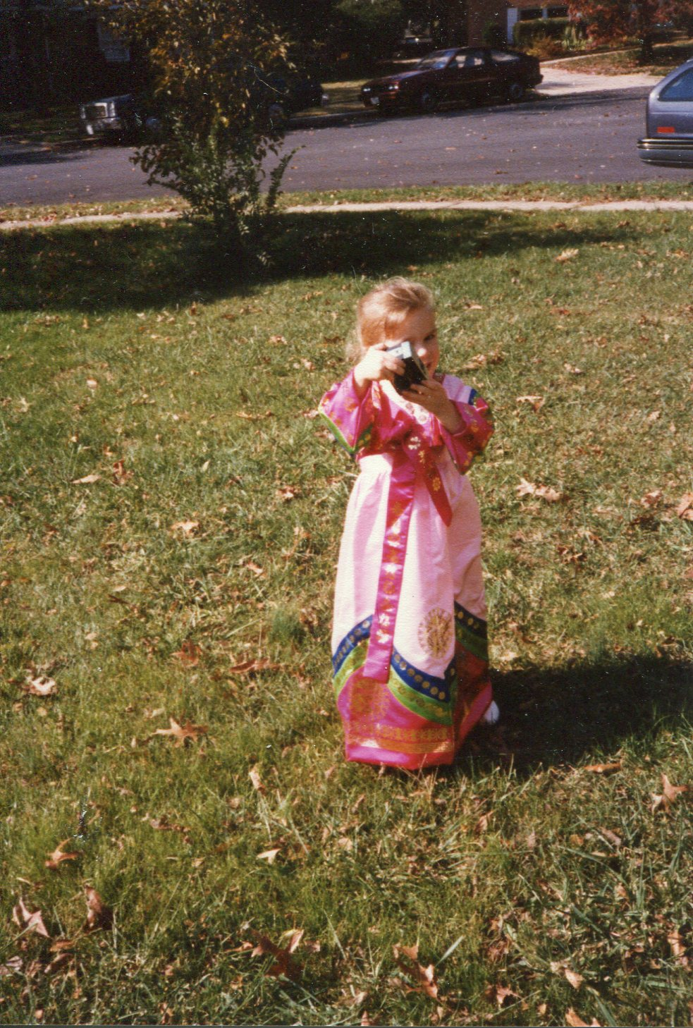 Me in traditional Korean dress, demonstrating an early love for camera.