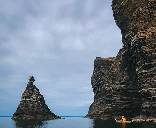 Sea kayaking around the cliffs of beautiful Bell Island 🛶⁣⁣ ⁣ ⁣ ⁣ ⁣ ⁣⁣ #nrthwrd #claimthenorth #seakayak #seakayaking #explorenewfoundland #explorenfld #explorenl #bellisland #atlanticcanada #explorecanada #travelcanada #atlanticocean #kayakingadventures #exploretocreate #gameoftones #moodyedits #travelguide #adventure_culture #eastcoast #exploreeast #imagesofcanada #cangeotravel #sharecangeo #kayakadventures #modernoutdoors #traveltoexplore