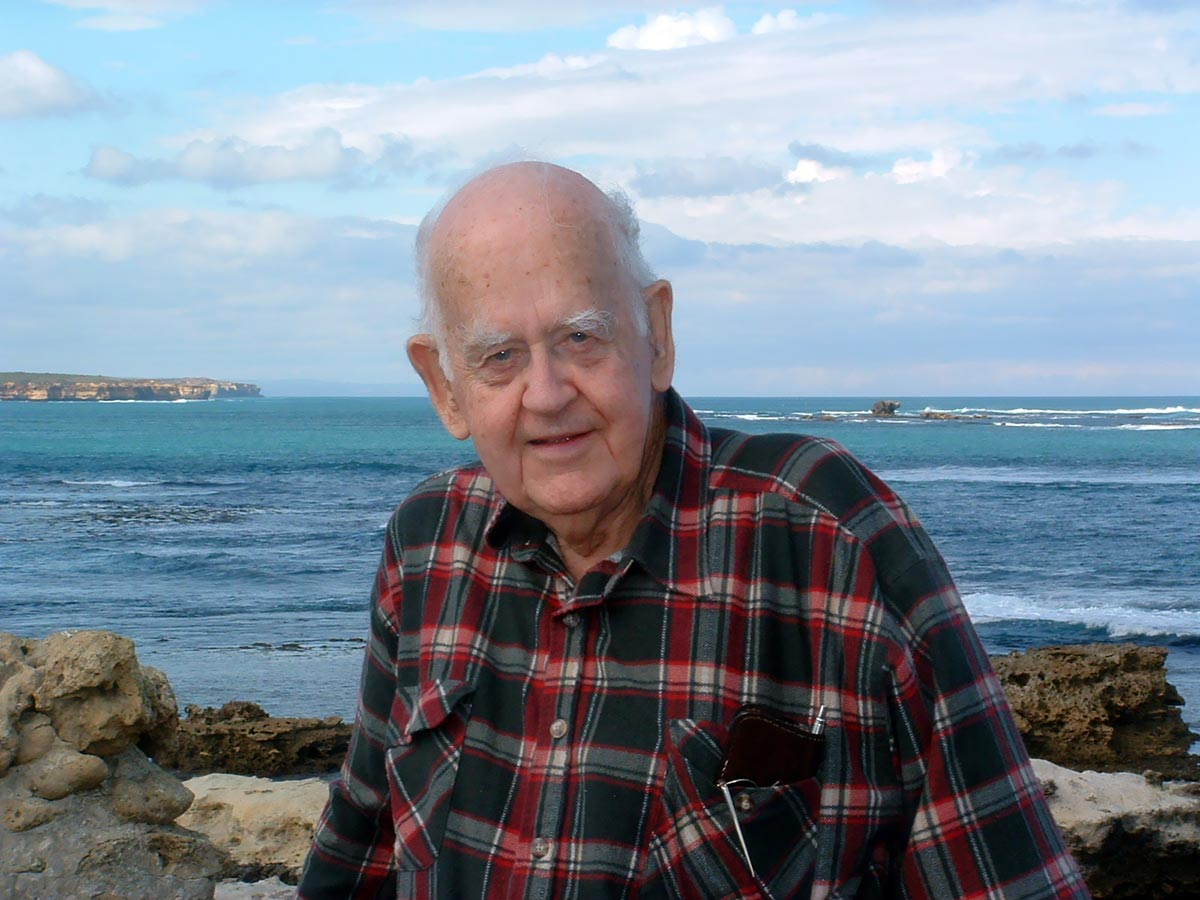 Don Charlwood in 2003. The Schomberg Rock - site of 1855 shipwreck - is in background.
