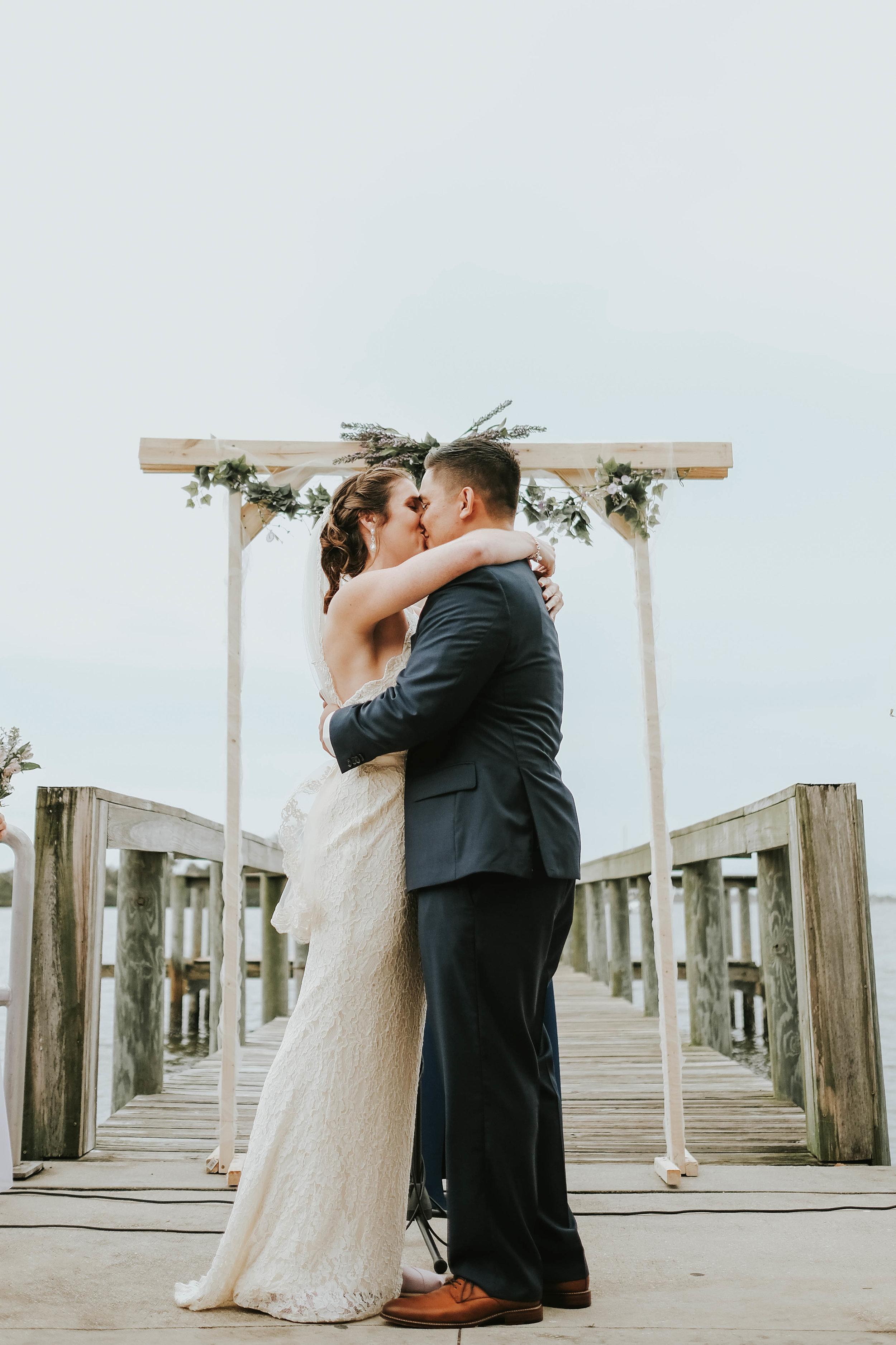 Bride and groom kiss front street wedding melbourne FL