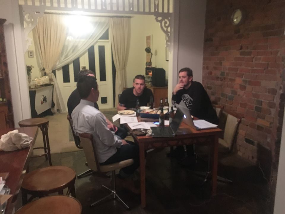 The team plotting world domination at Elle's kitchen table.
