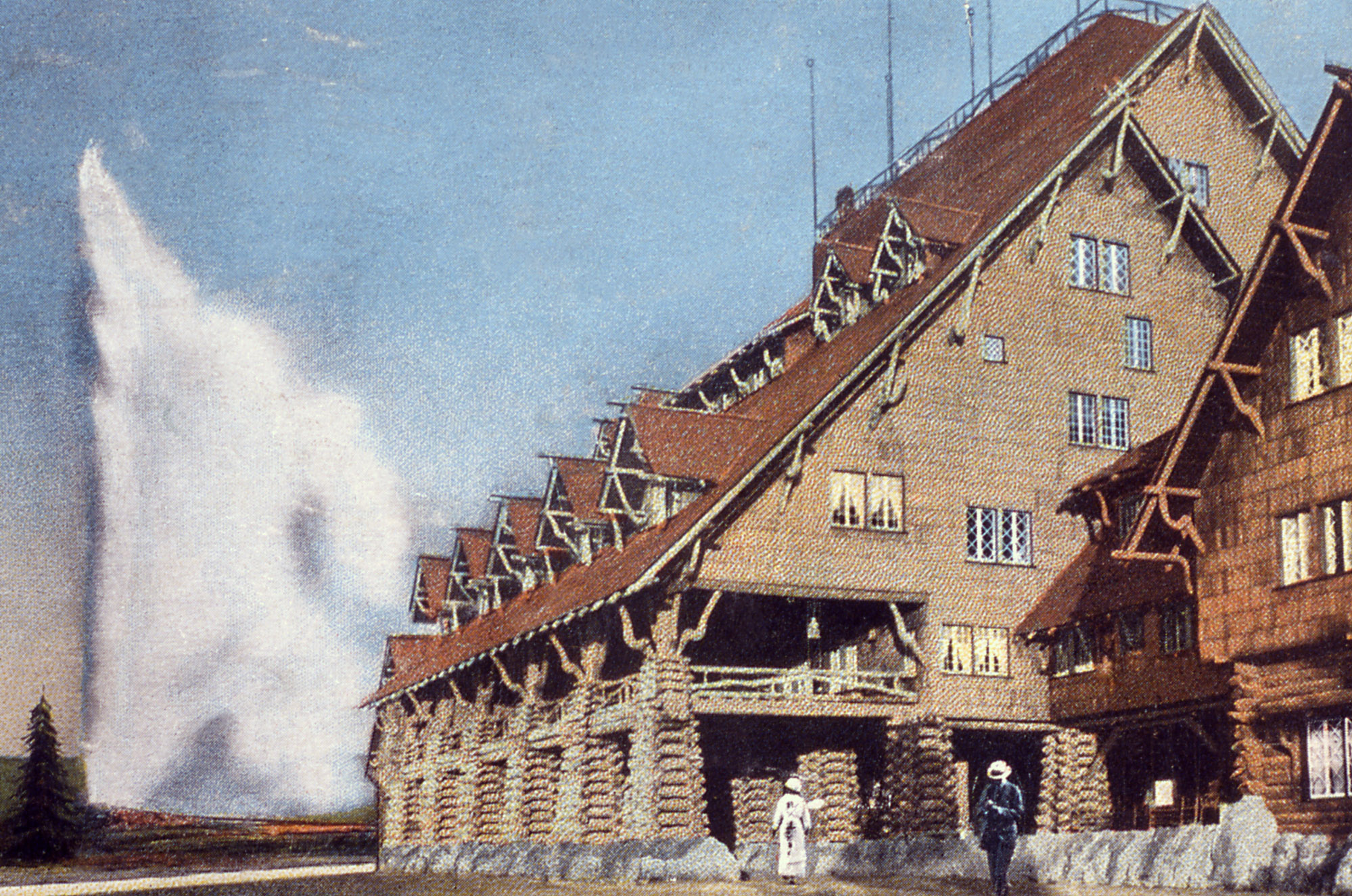 An old postcard of Old Faithful Inn at Yellowstone National Park.