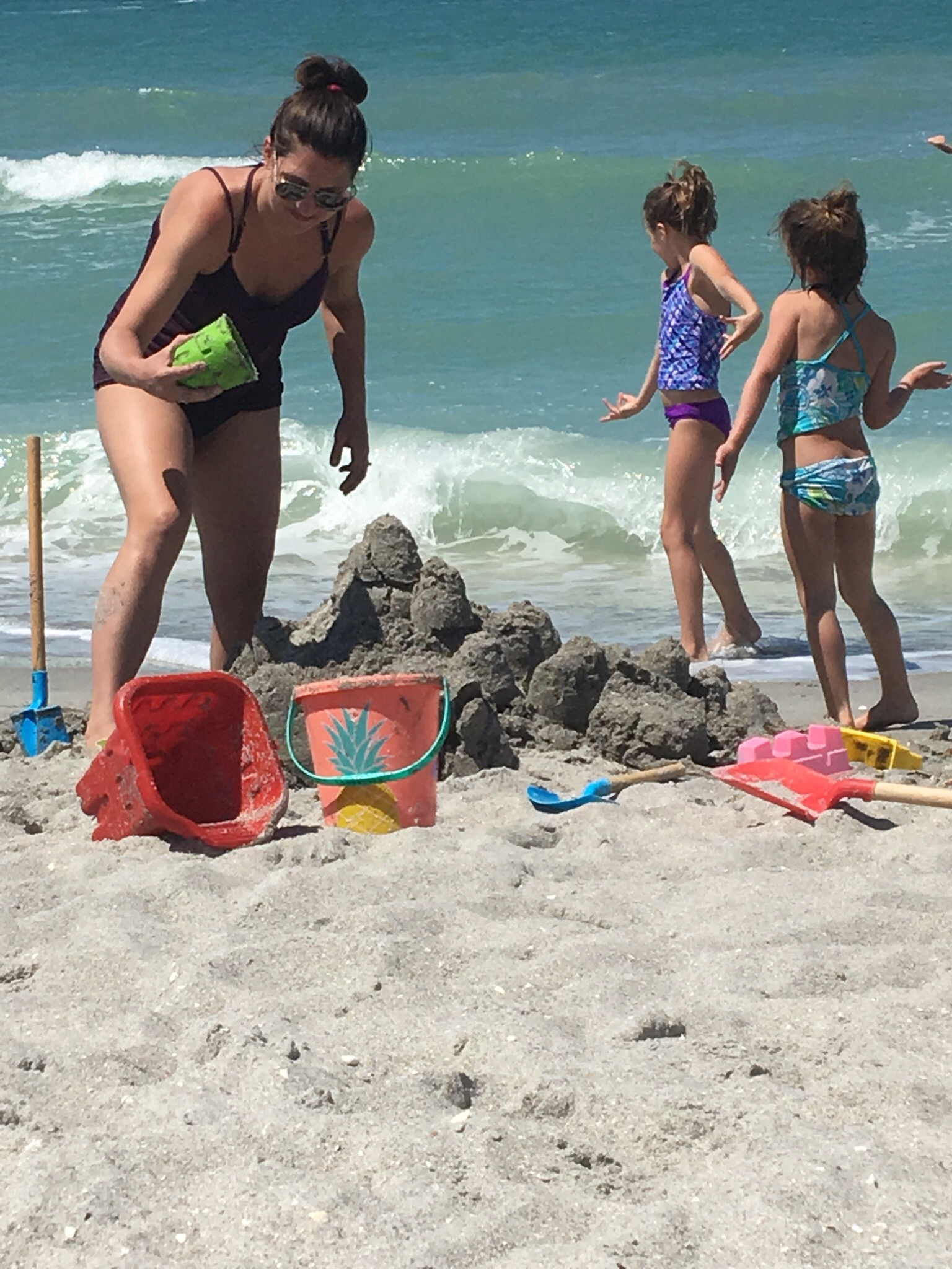 Here's a pic of me making what very well might be my first sandcastle ever. (Just a side note but I've also found that I'm much more creative now that I've quit drinking. We have this misconception that using substances fuels creativity but you know what really does it? A clear head!)