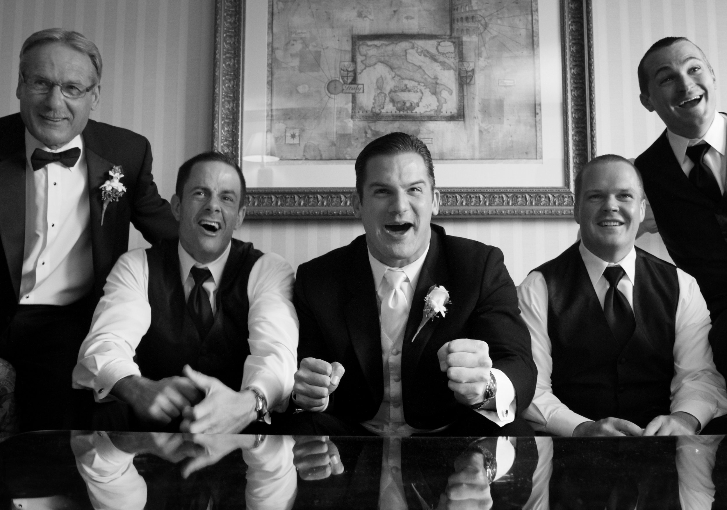wedding-groom-groomsman-fun-humour-candid-sports-black-and-white-image